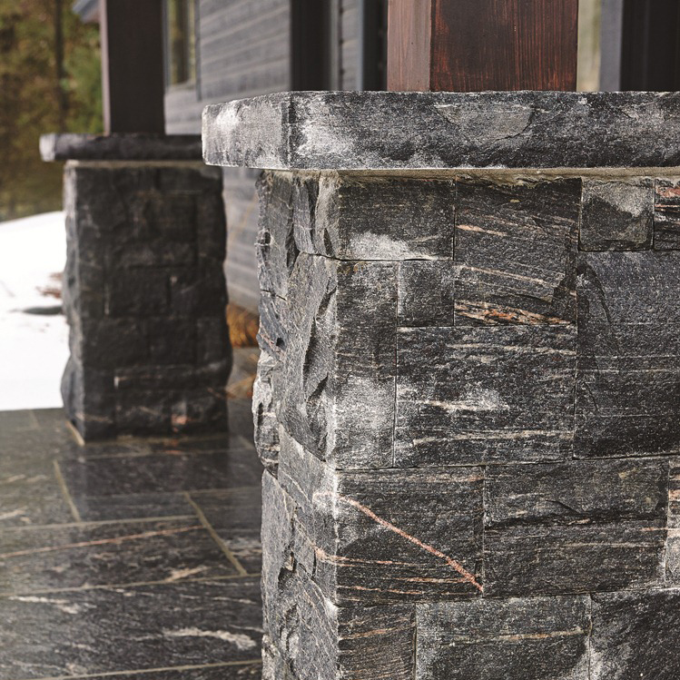 EXTERIOR - Naturalize the exterior of your home with the installation of our custom stonework. Our masonry will mirror your area's natural beauty by intermingling the grace and grandeur of locally sourced stone and granite.