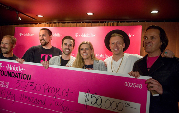 30/30 Project Founder, Julie Lewis, Macklemore and Ryan Lewis celebrate donation from T-Mobile CEO John Legere.