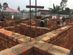 Laying bricks for the Rugerero Clinic, August 2017.