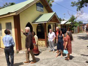 From-left-Pastor-Reginald-Joseph-Bill-Clinton-Julie-Joseph-Tom-Secunda-Miles-Stair-Katherine-Cheng-and-Cindy-Secunda-in-front-of-the-Cruz-Bay-Baptist-Church.-300x225