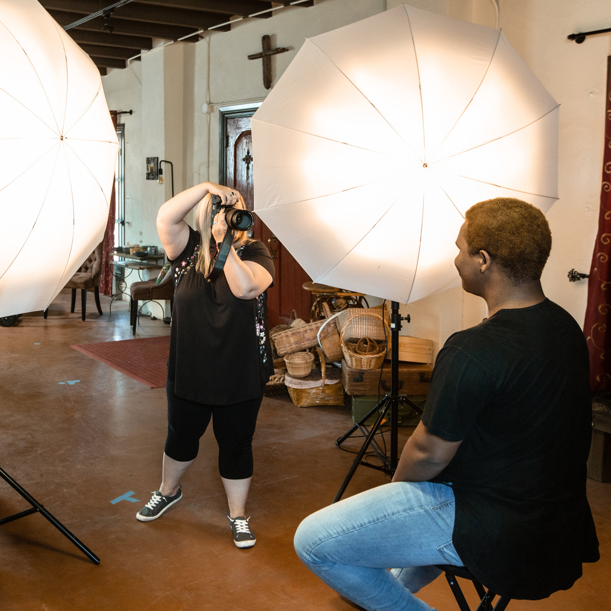 Michelle Burley setting up a corporate portrait -