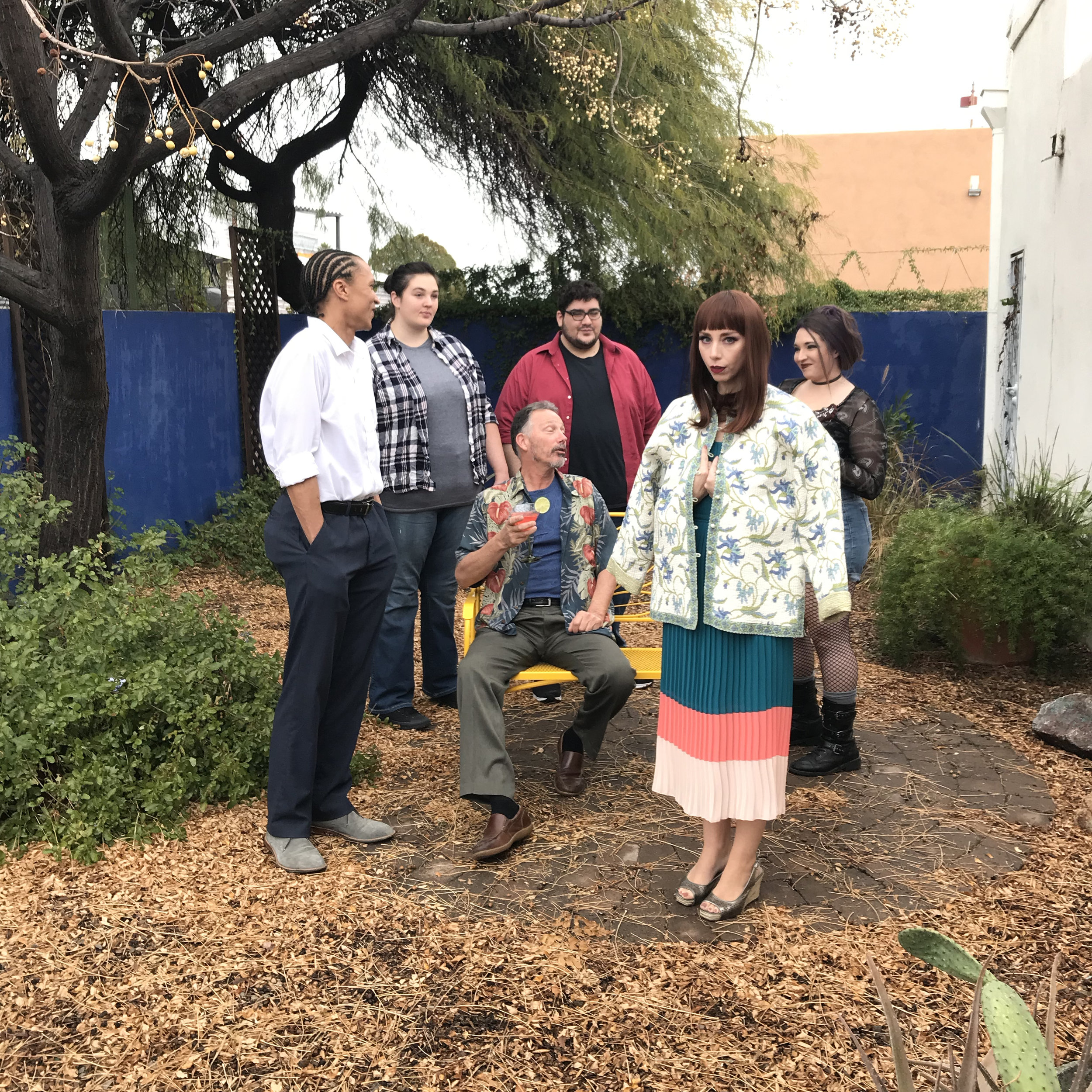 setting up a group of actors in the garden for a promo photo image for winding road theater ensemble's production of stupid f*cking bird -