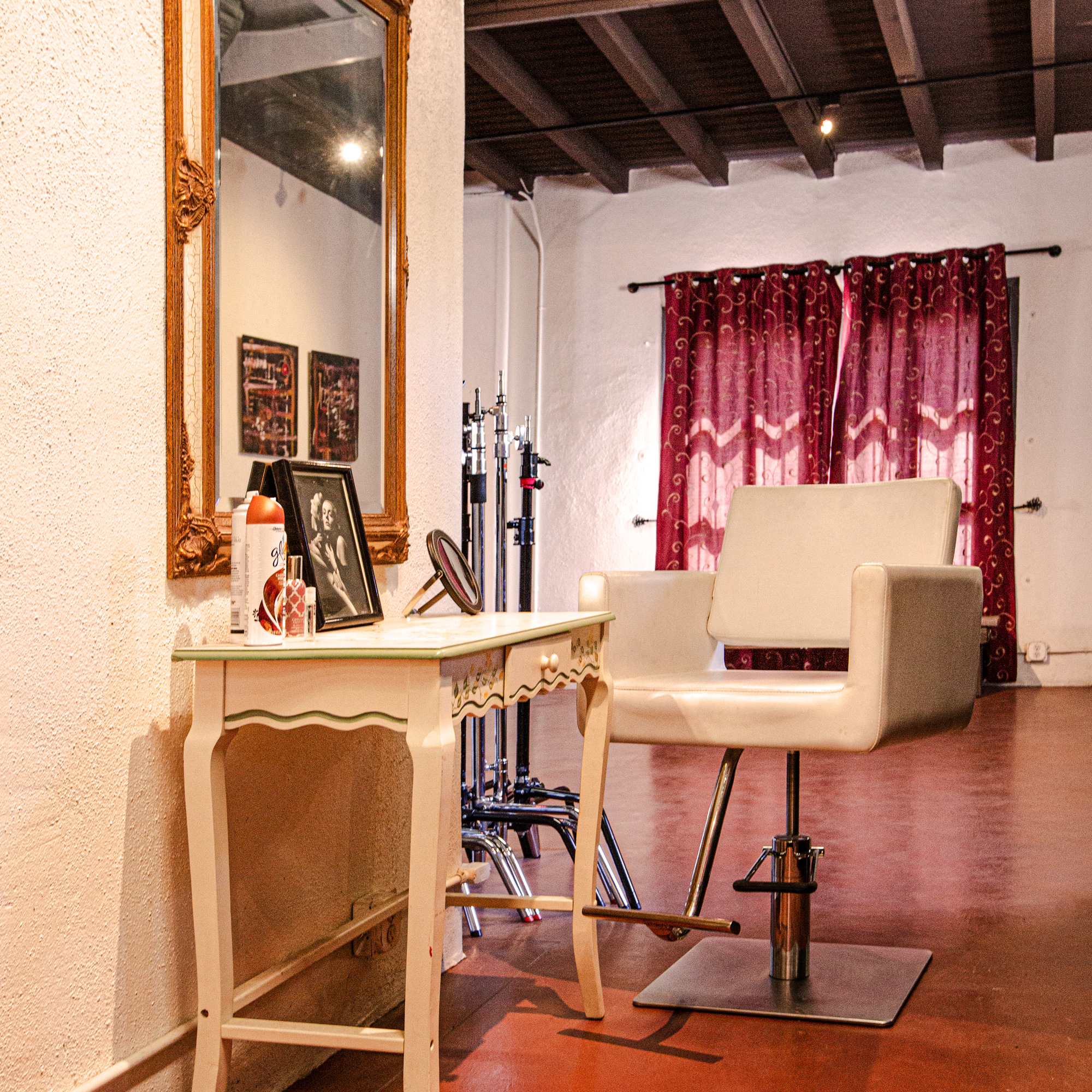 dedicated hair and makeup area - Whether your clients or models are doing their own hair and makeup or working with a pro, this area is well-lit with a tall chair and big mirror. There's a clean, bright, ADA-accessible studio restroom right down the hall.