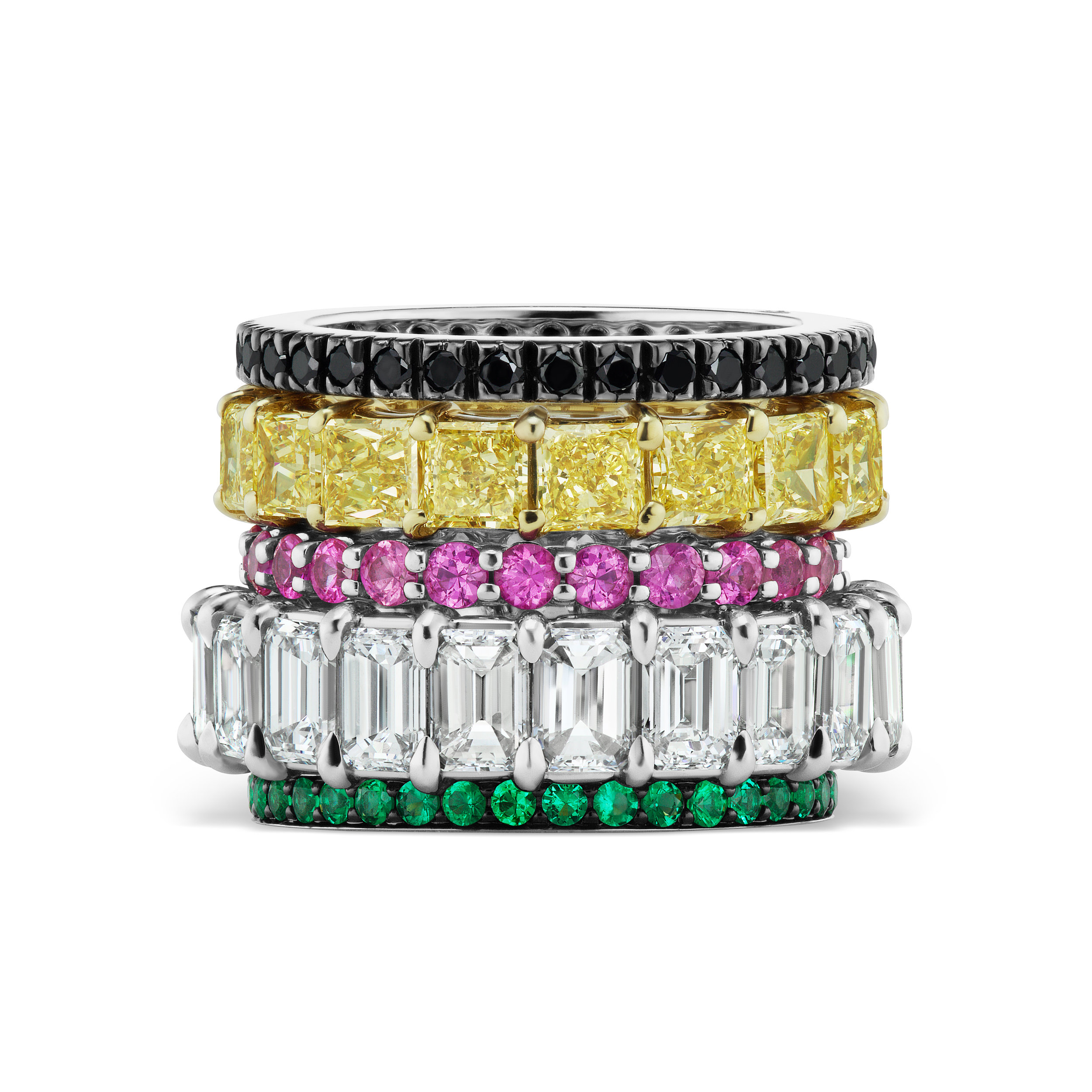 Stack of colored diamond and colored stone bands.
