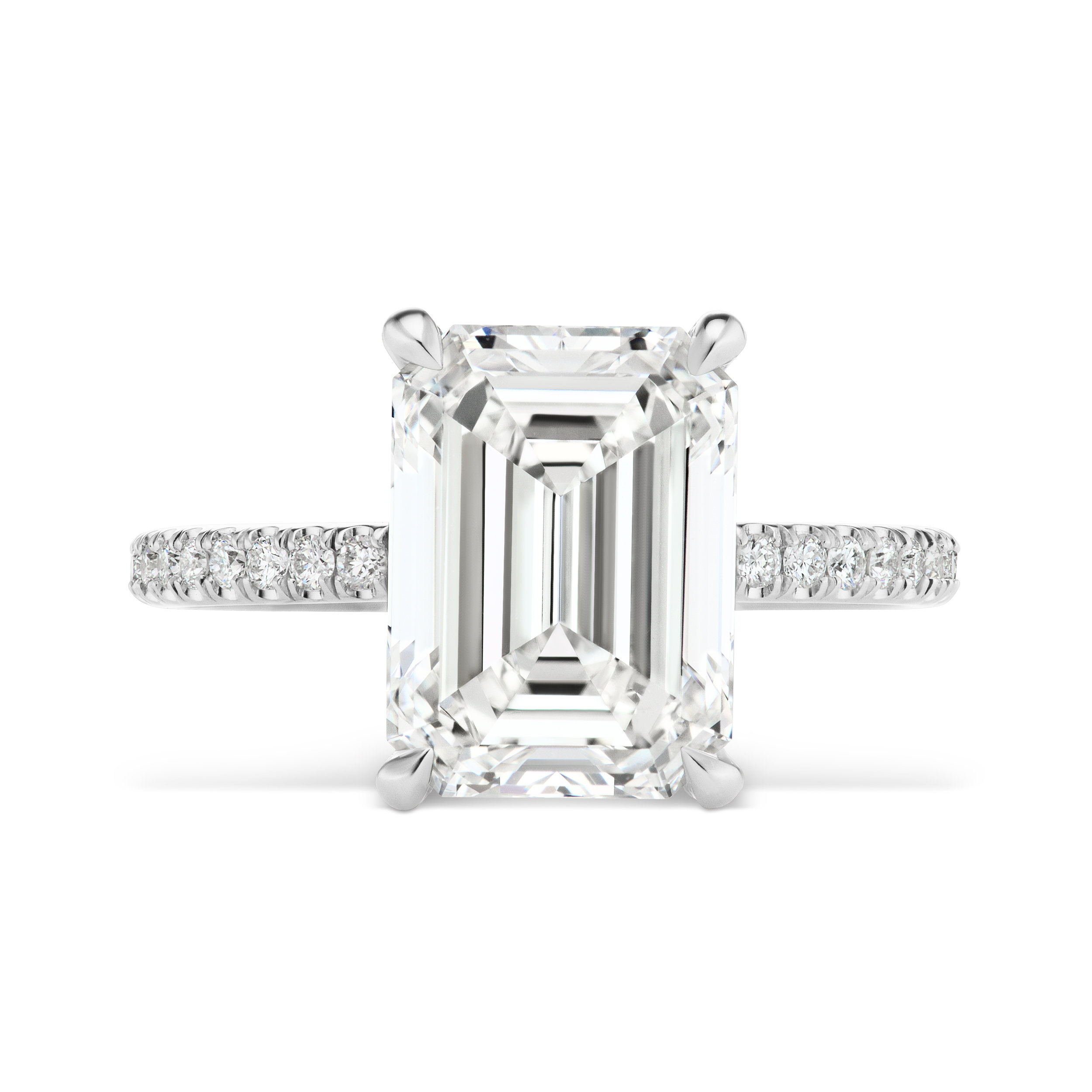 Emerald cut diamond ring with micropavé diamond band, mounted in platinum.