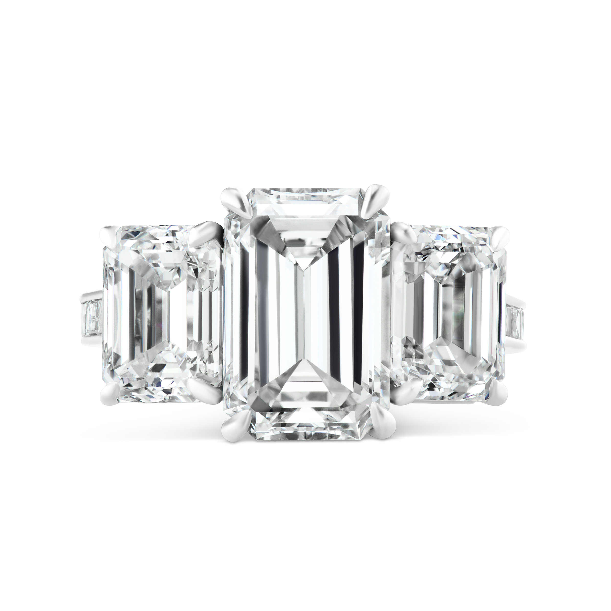 Emerald cut diamond ring with emerald cut side stones and diamond baguette band, mounted in platinum.