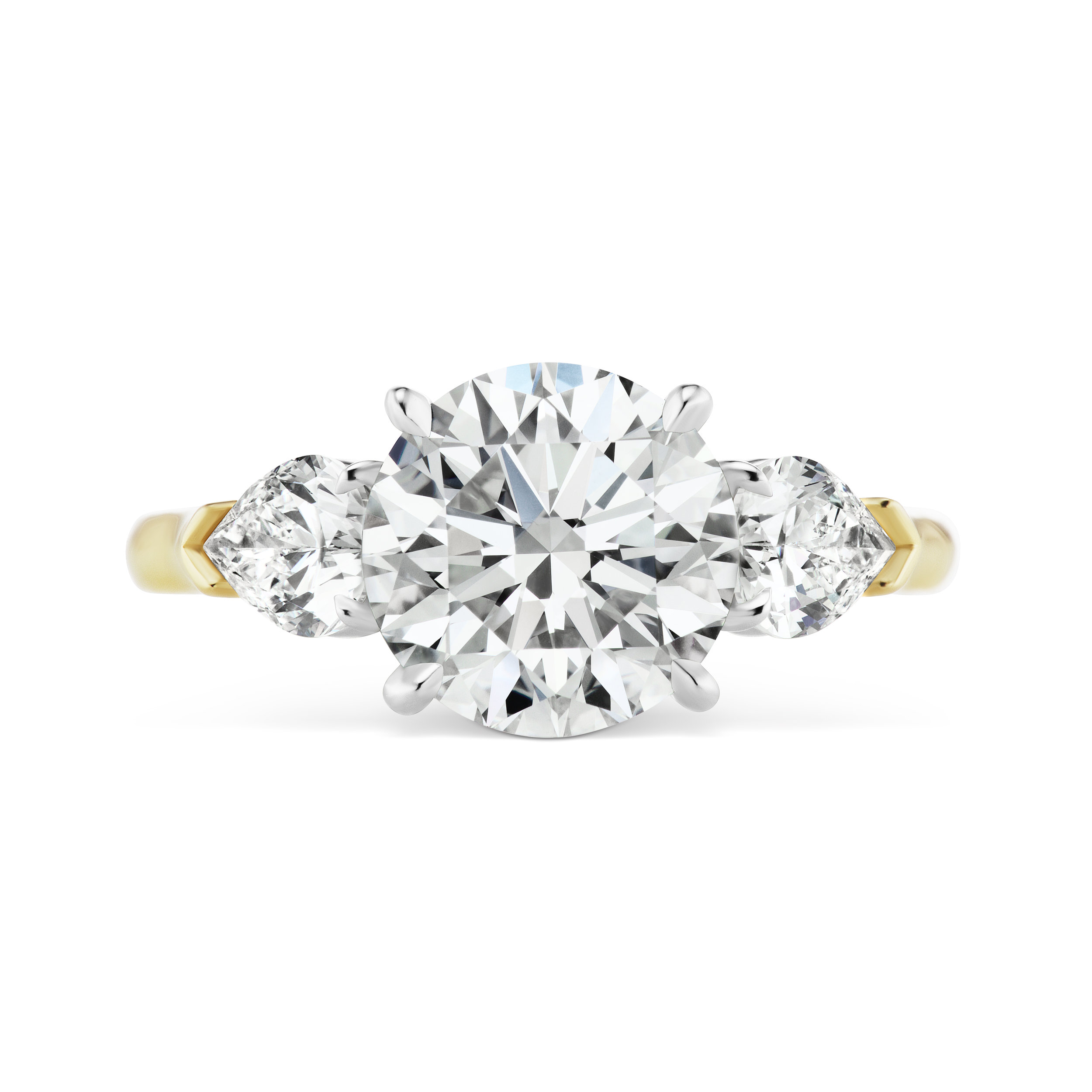 Round brilliant diamond ring with pear-shaped side stones, mounted in yellow gold and platinum.