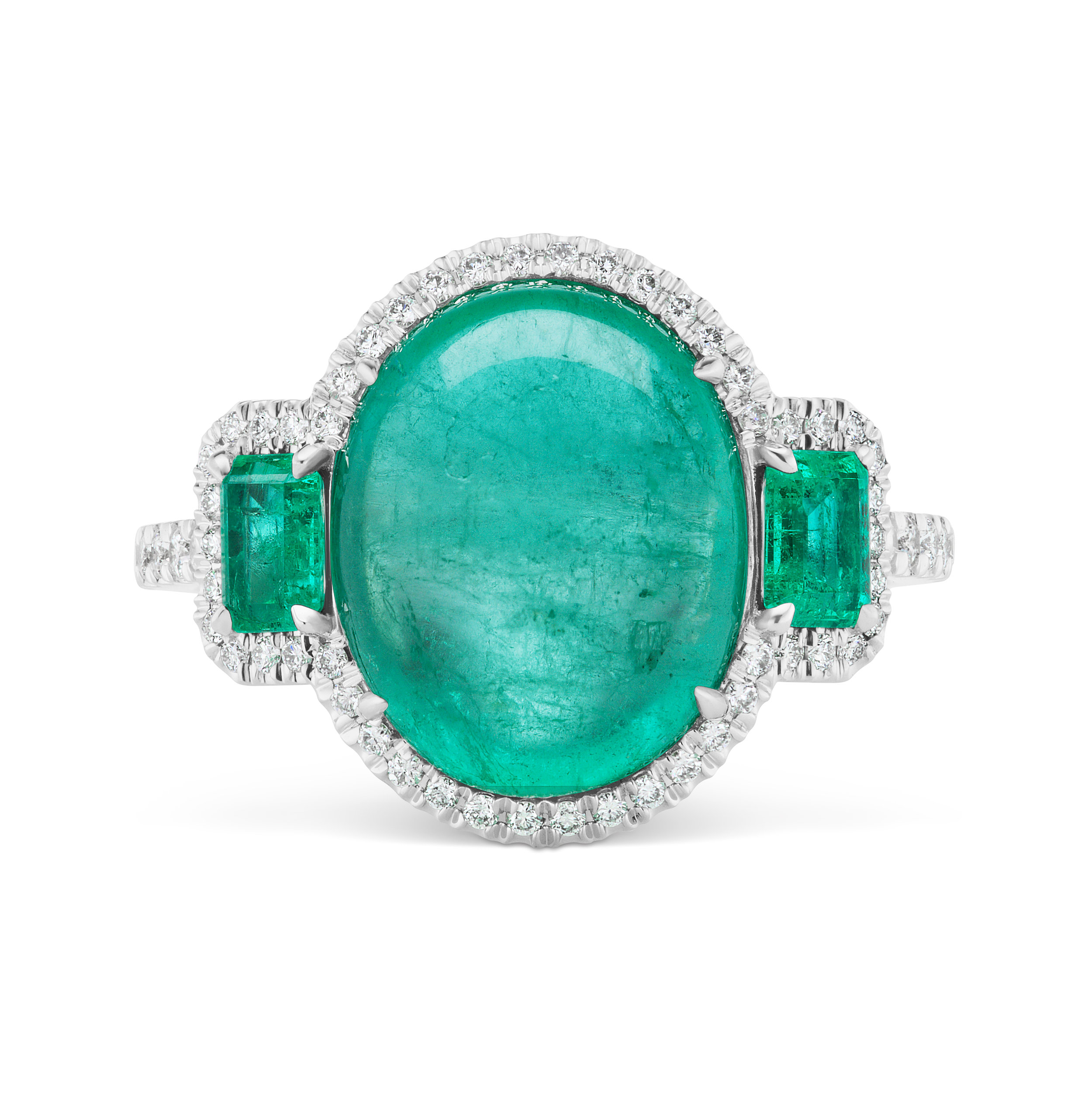 Colombian emerald three-stone ring with micropavé diamond trim and band, mounted in platinum.