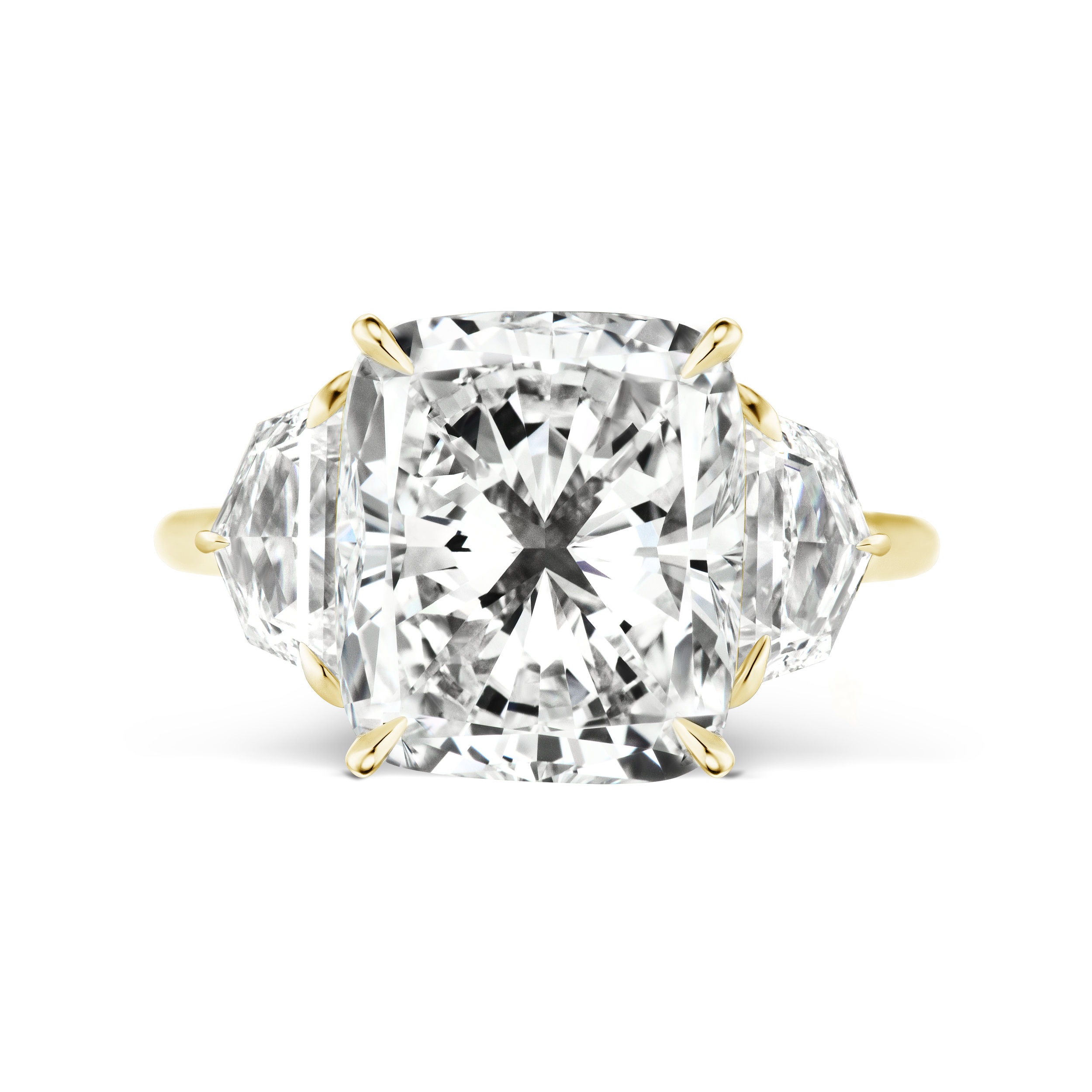 Cushion cut diamond ring with epaulette side stones, mounted in yellow gold.