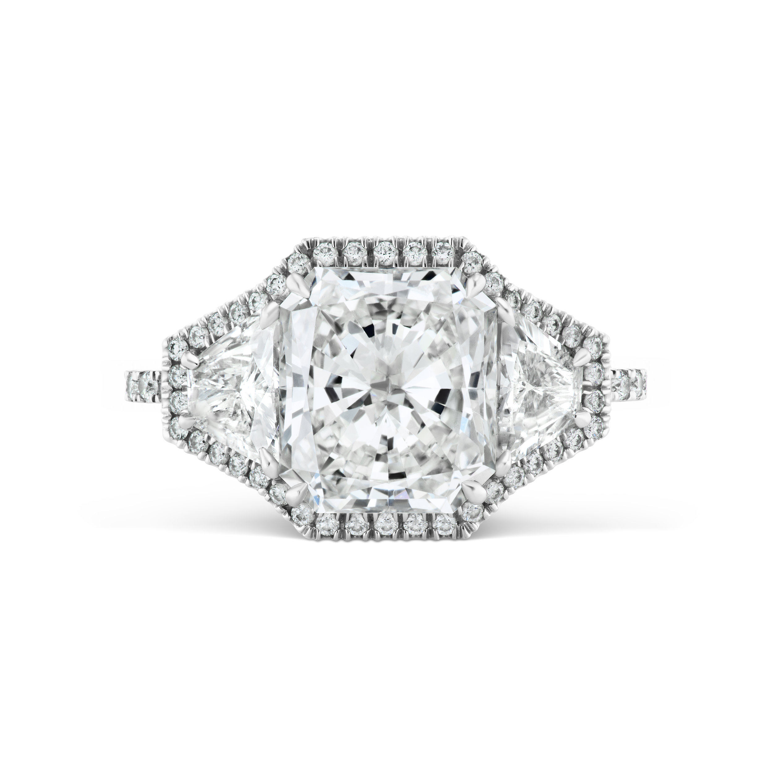 Radiant cut diamond ring with micropavé diamond trim and band, mounted in platinum.
