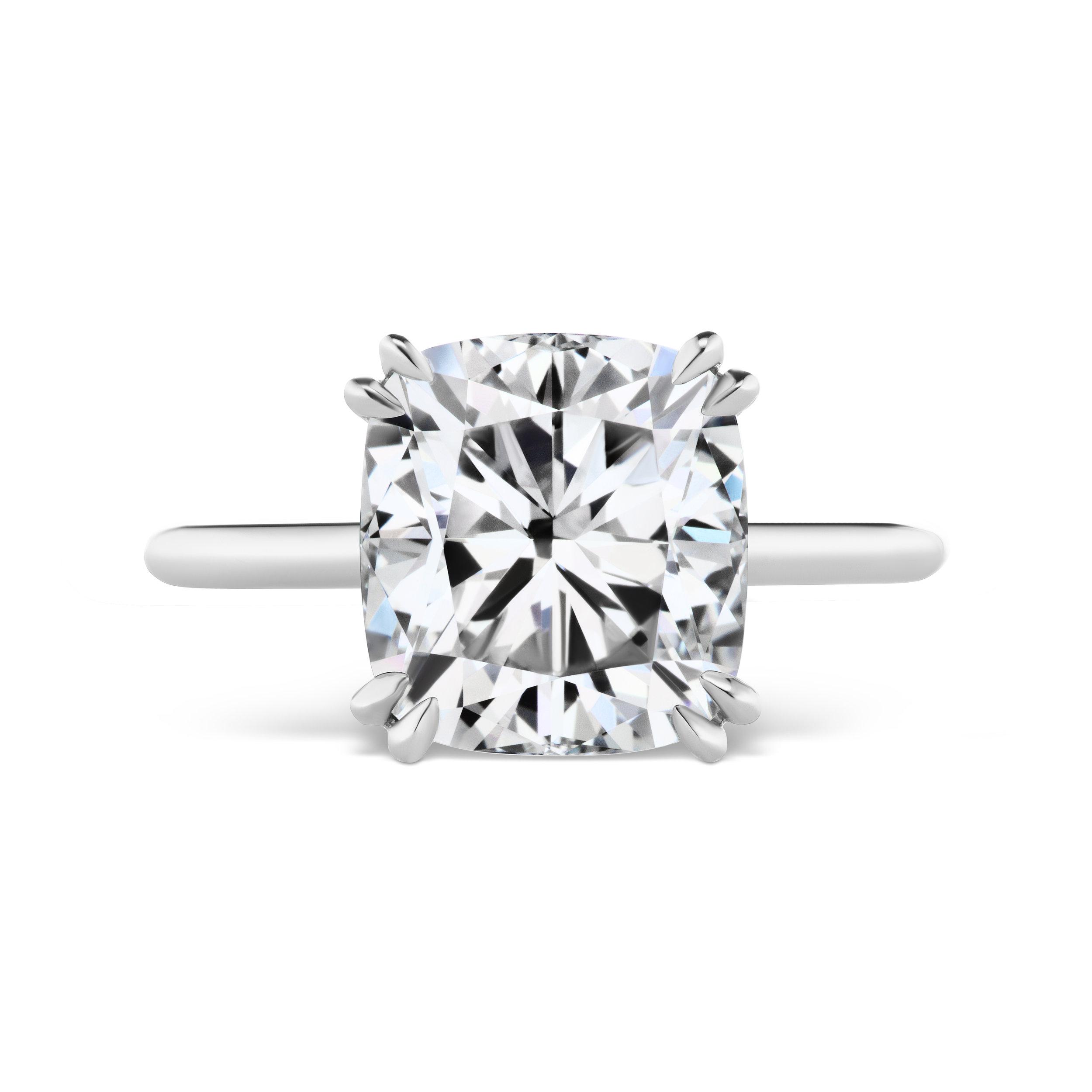 Cushion cut diamond ring, mounted in platinum.