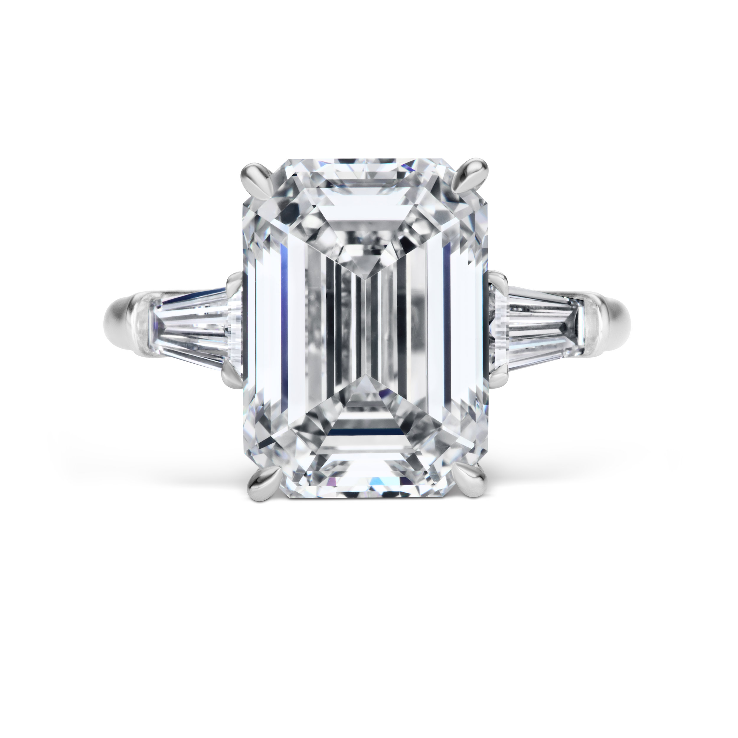 Emerald cut diamond ring with tapered baguettes, mounted in platinum.