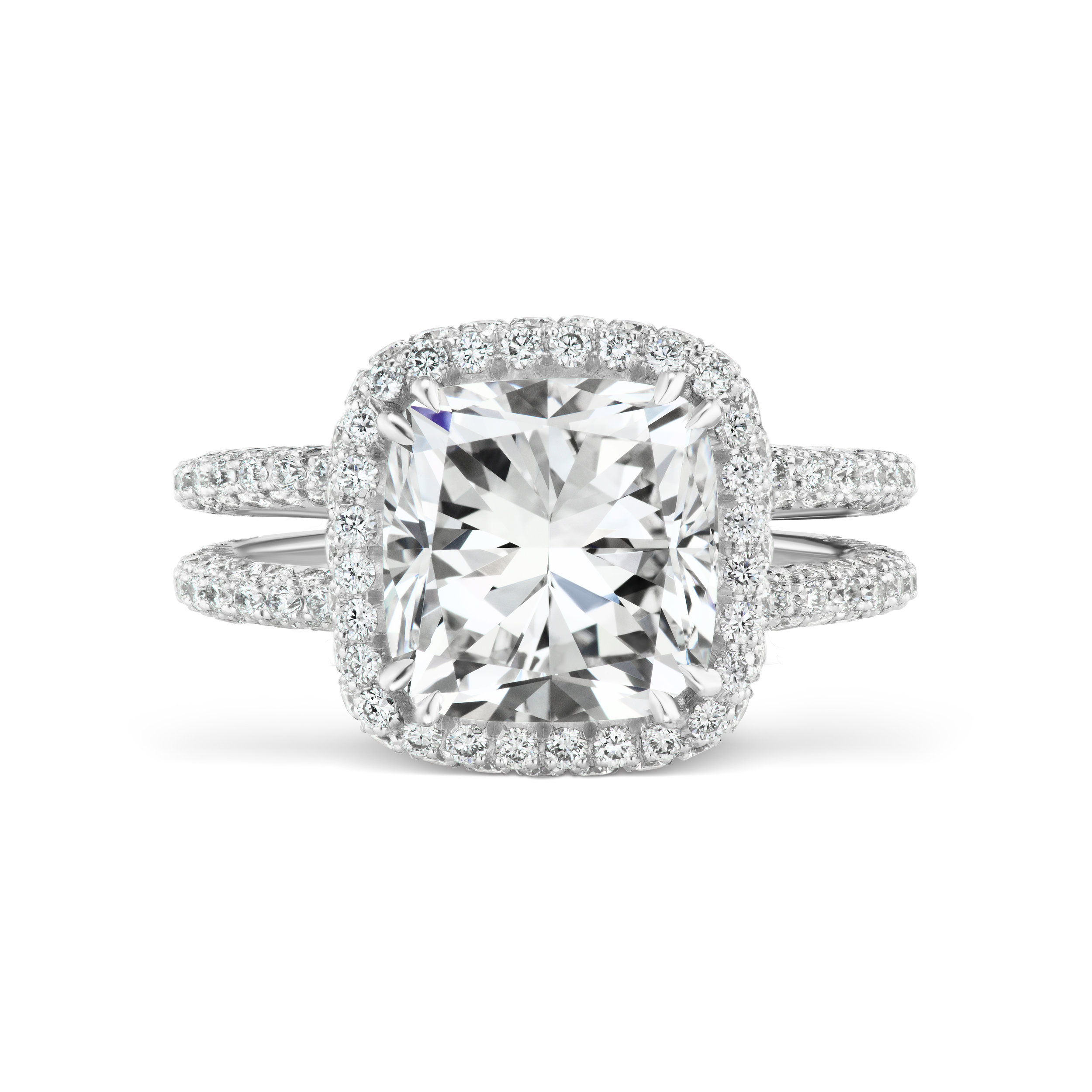 Cushion cut diamond ring with micropavé diamond double band, mounted in platinum.