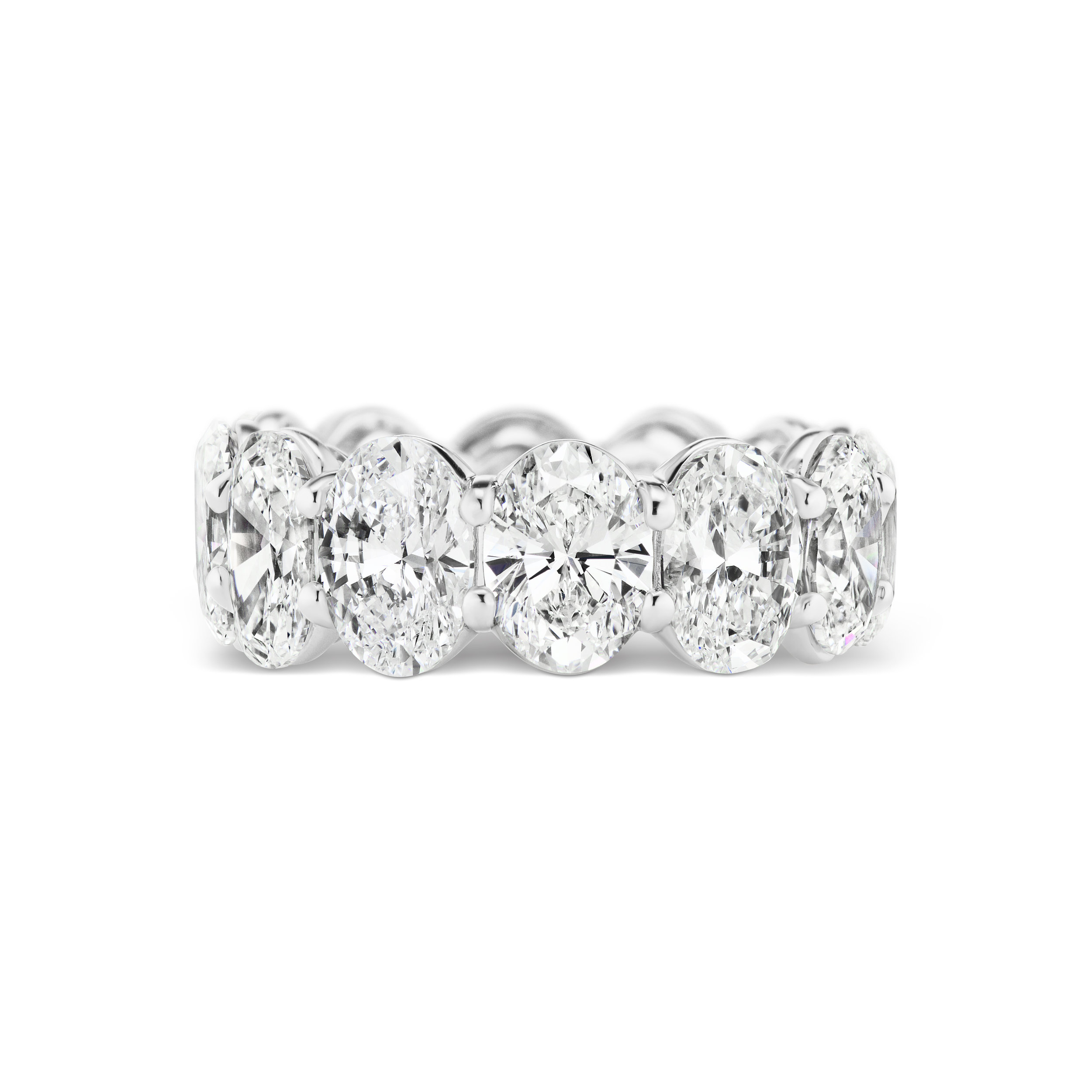 Oval diamond eternity band, mounted in platinum.