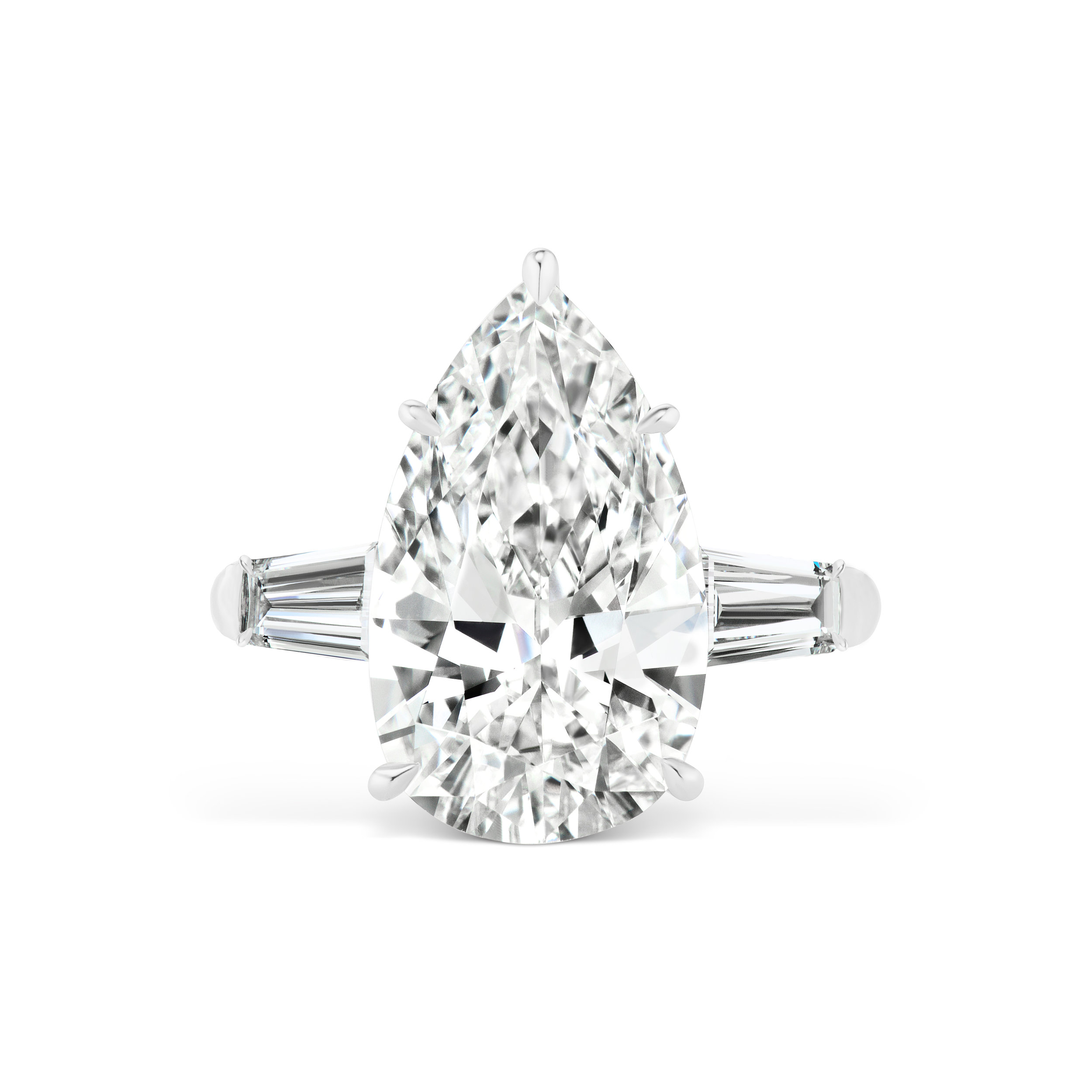 Pear shaped diamond ring with tapered baguette side stones, mounted in platinum.