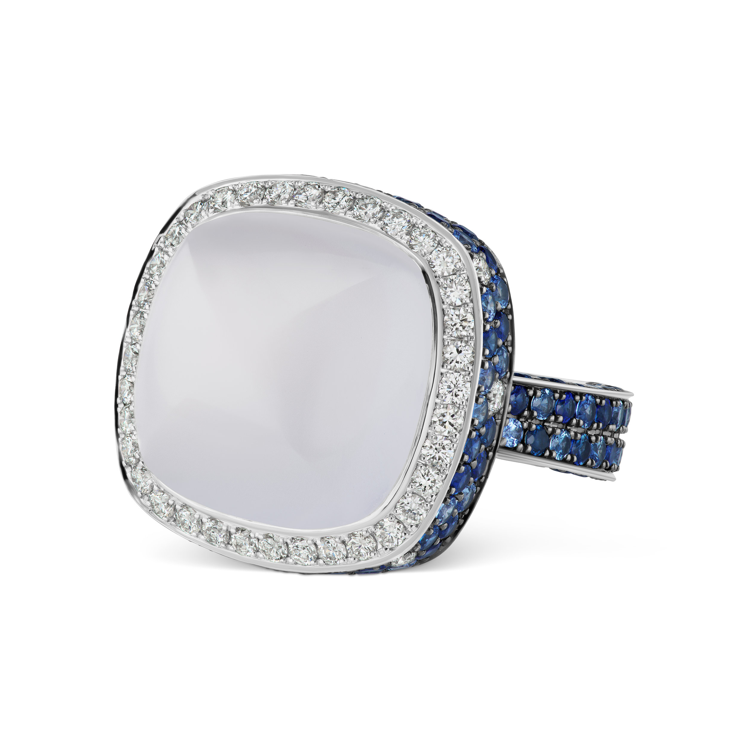 Moonstone ring with micropave diamond trim and sapphire band, mounted in platinum.