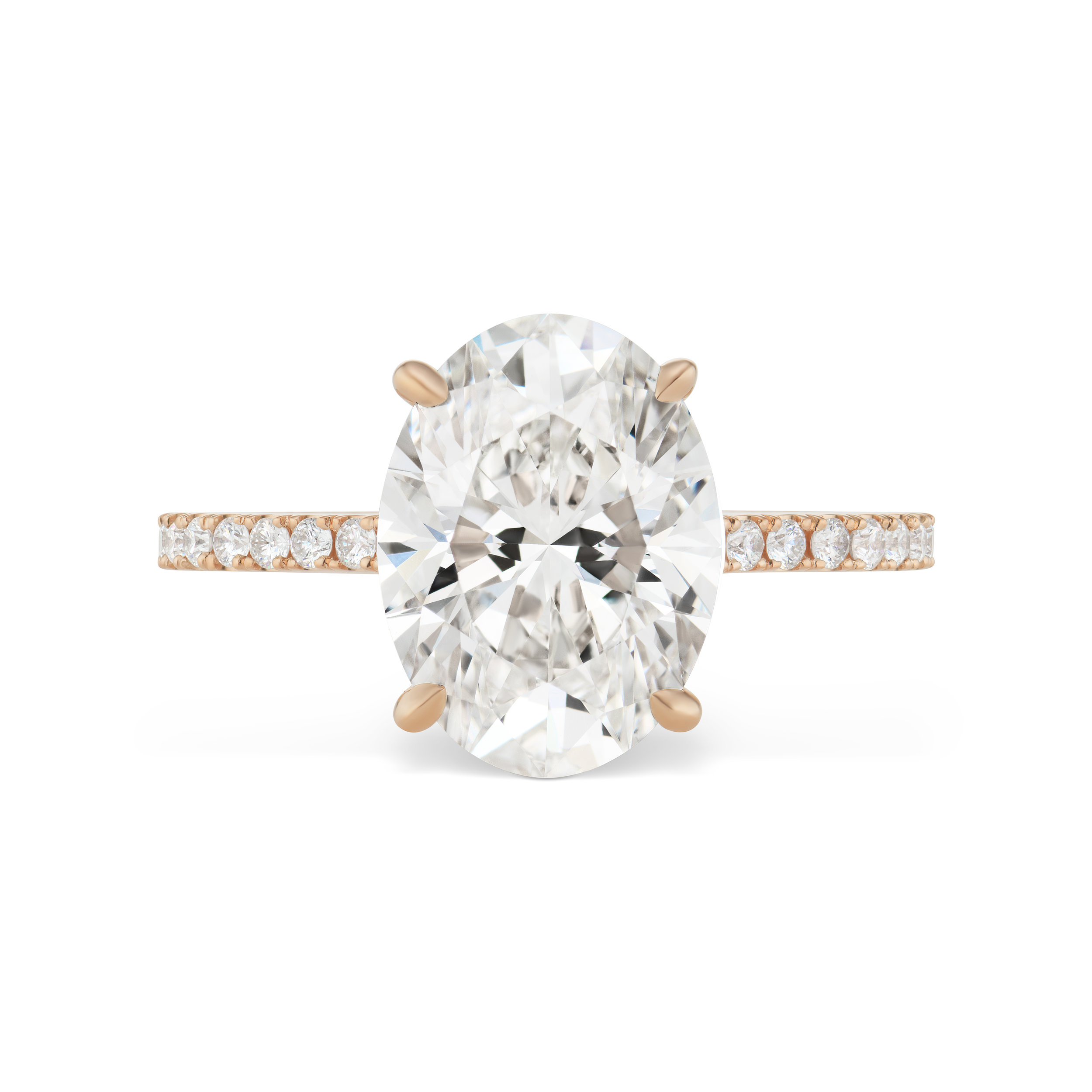 Oval diamond ring with micropavé band, mounted in rose gold. .jpg