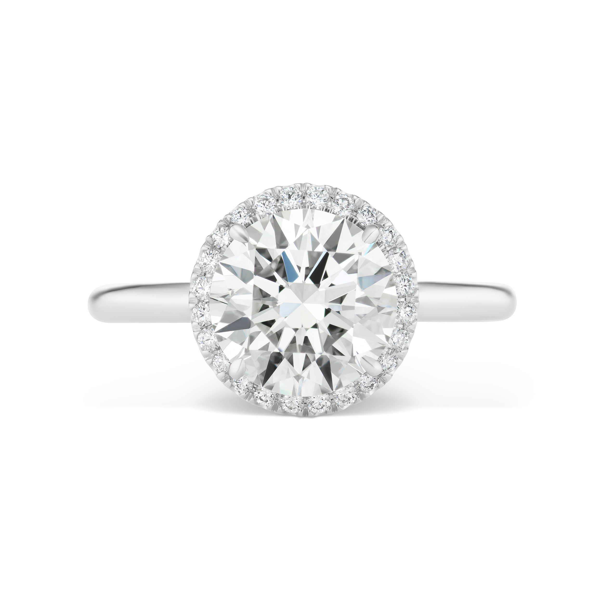 Round brilliant diamond ring with micropavé trim, mounted in platinum.jpg