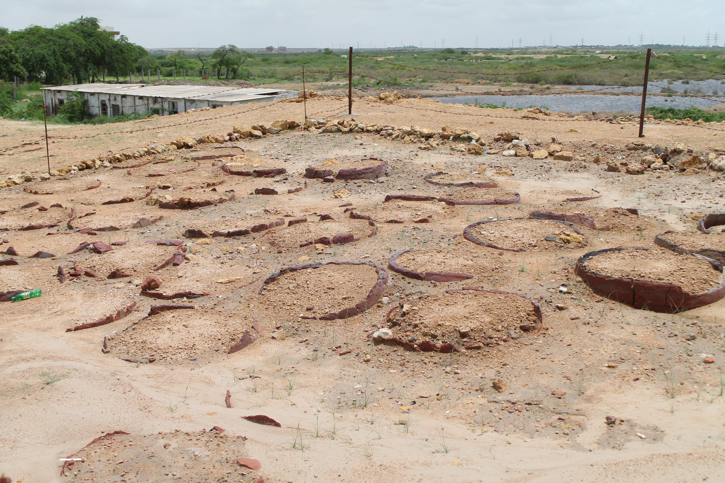 Archaeological remains of the wells where dhobis washed clothes in Bhambhore