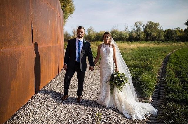 Another stunner! Photographers see art with the metal wall. @ericschwantes #weddingparty #weddingstyle #roseriverreceptions #idahoweddingvenue #idahowedding #eastidahoweddingvenue #eastidahowedding #riverwedding #outdoorweddingvenue #idahobride #eastidahobride #roseriverreceptions