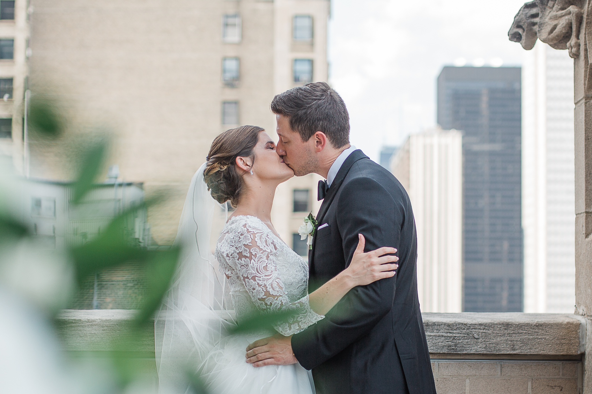 Bride and Groom kissing on roof top.