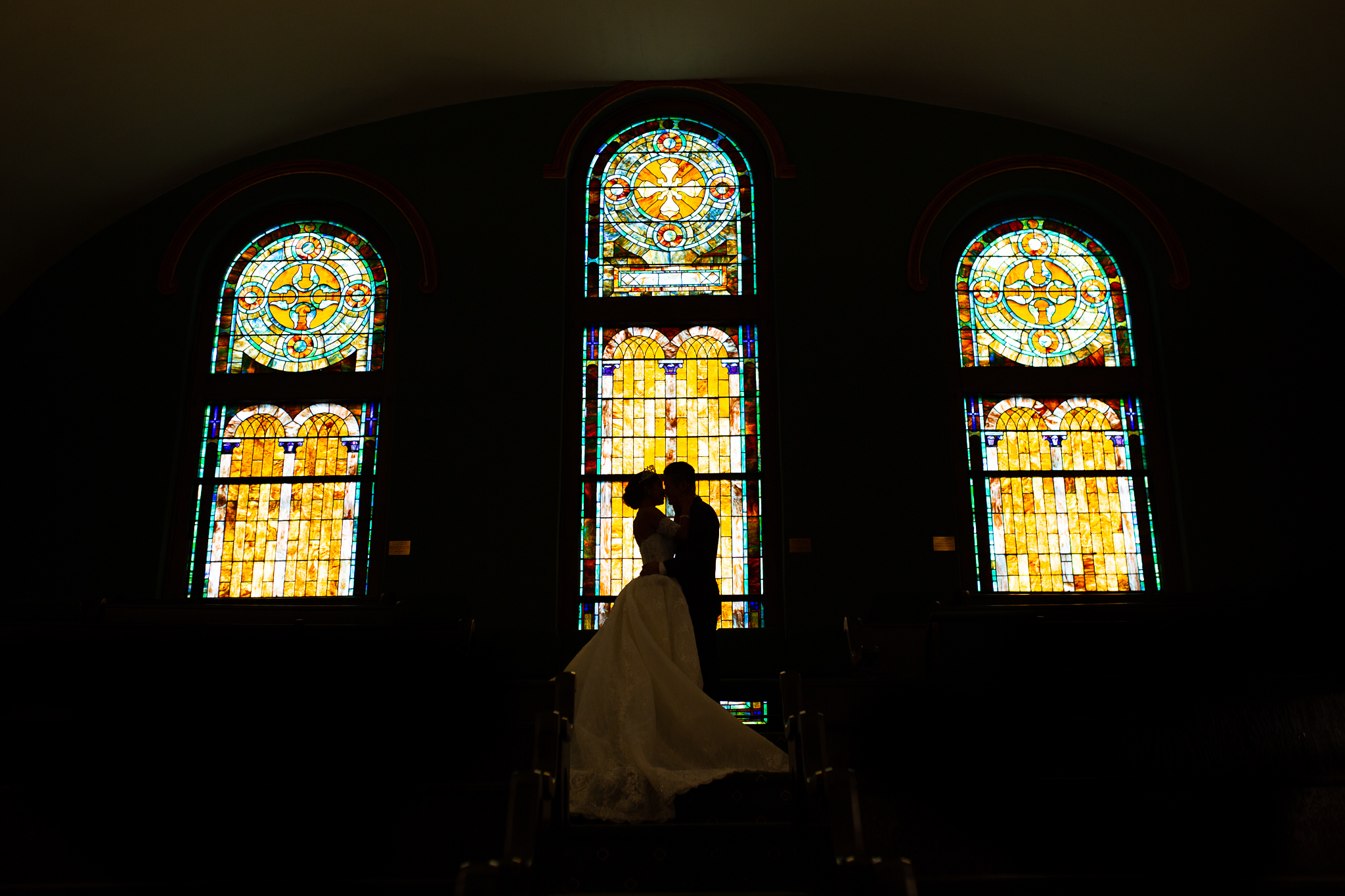 Bride and Groom Kissing inside church.