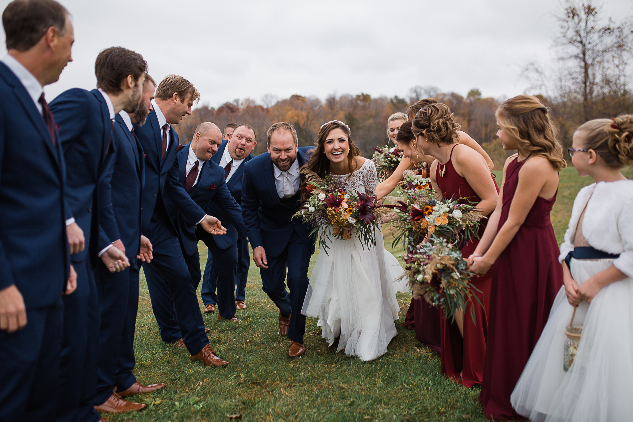 Bride and groom celebrating with their bridal party.