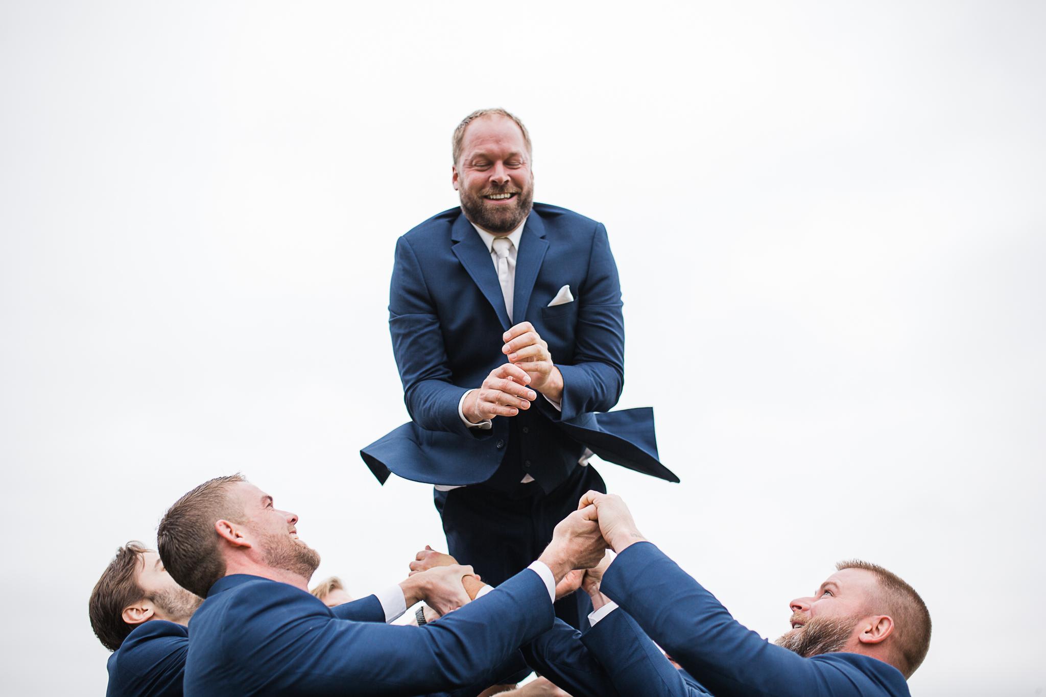 Groom toss with groomsmen