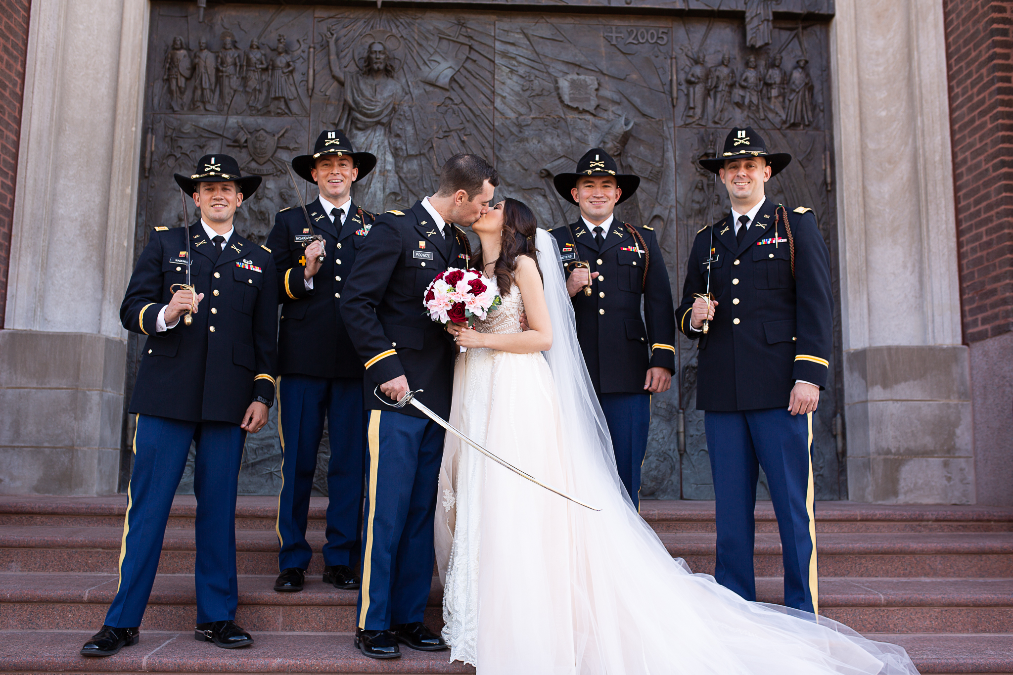 Bride and groom posing with bridal party Marines