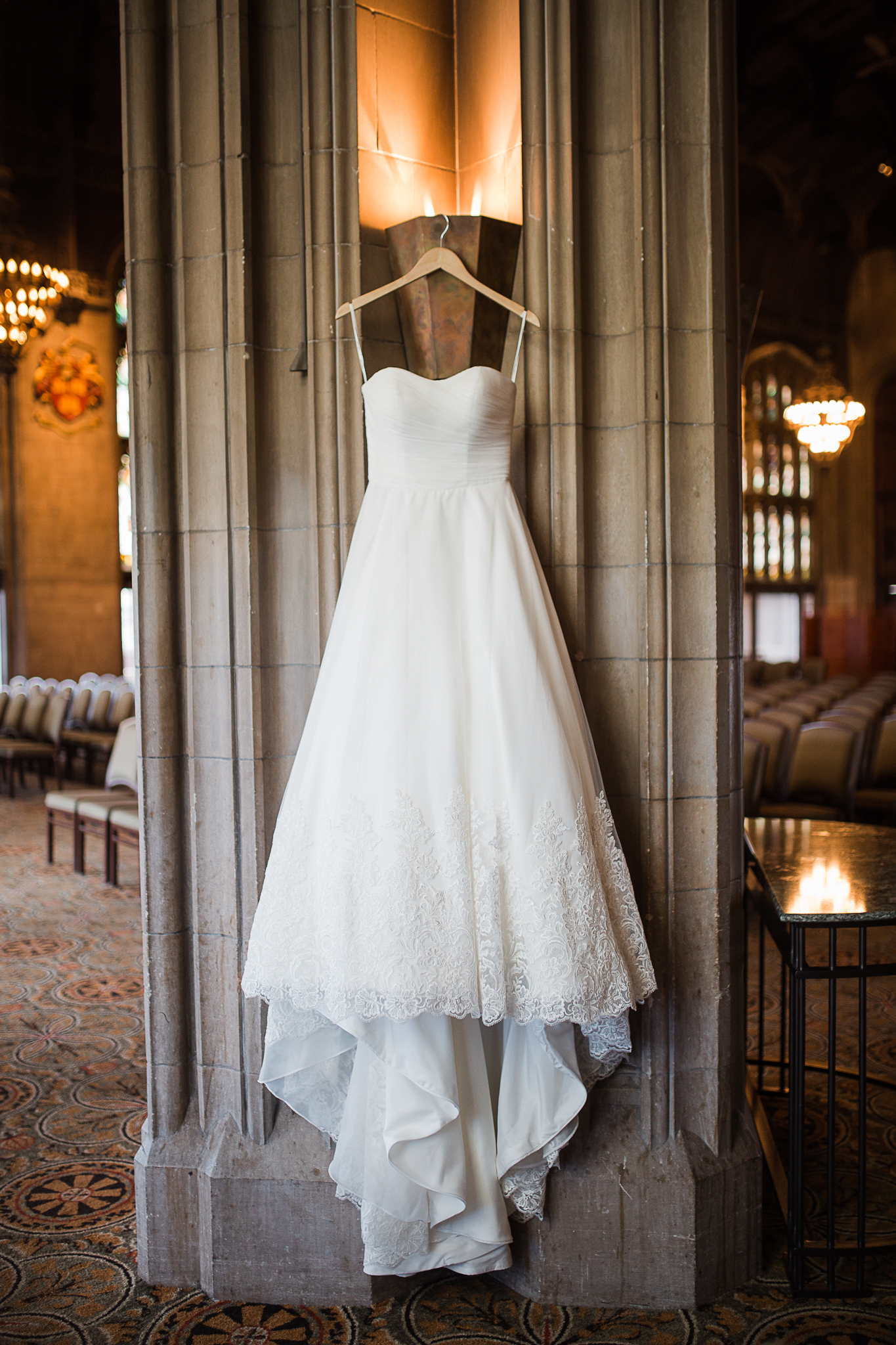 detail shot of brides dress at ceremony location