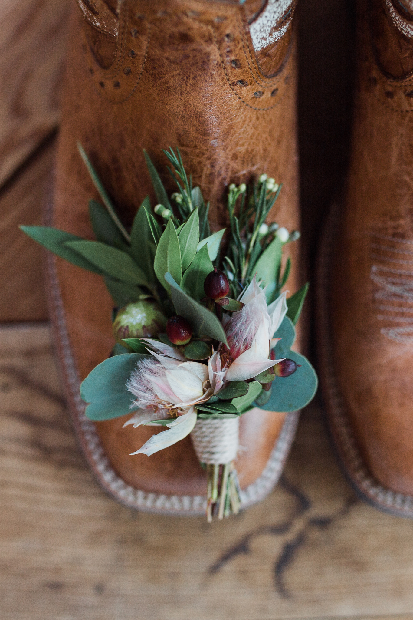 detail shot of grooms shoes and flowers