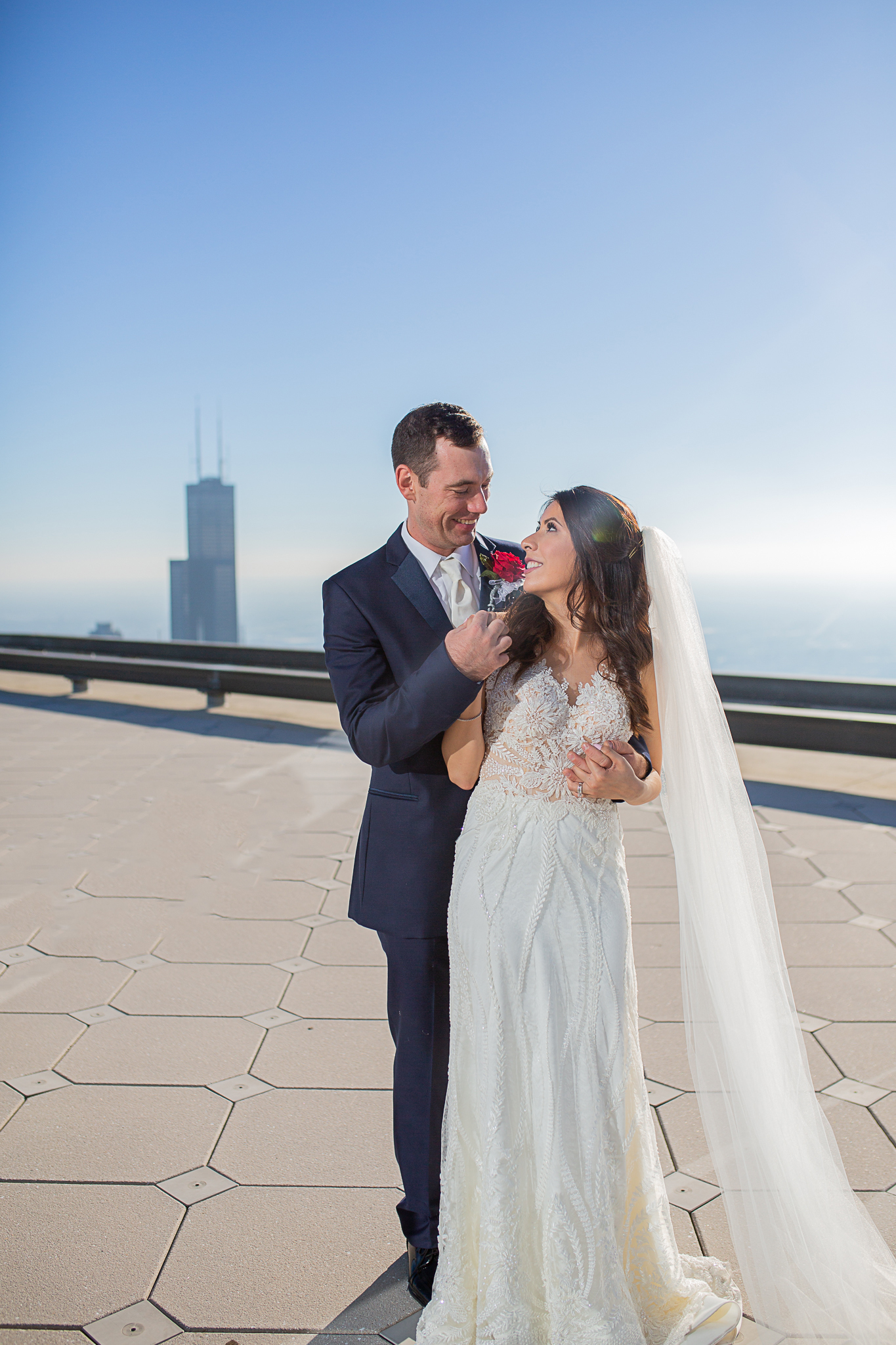 Bride and groom on rooftop downtown Chicago