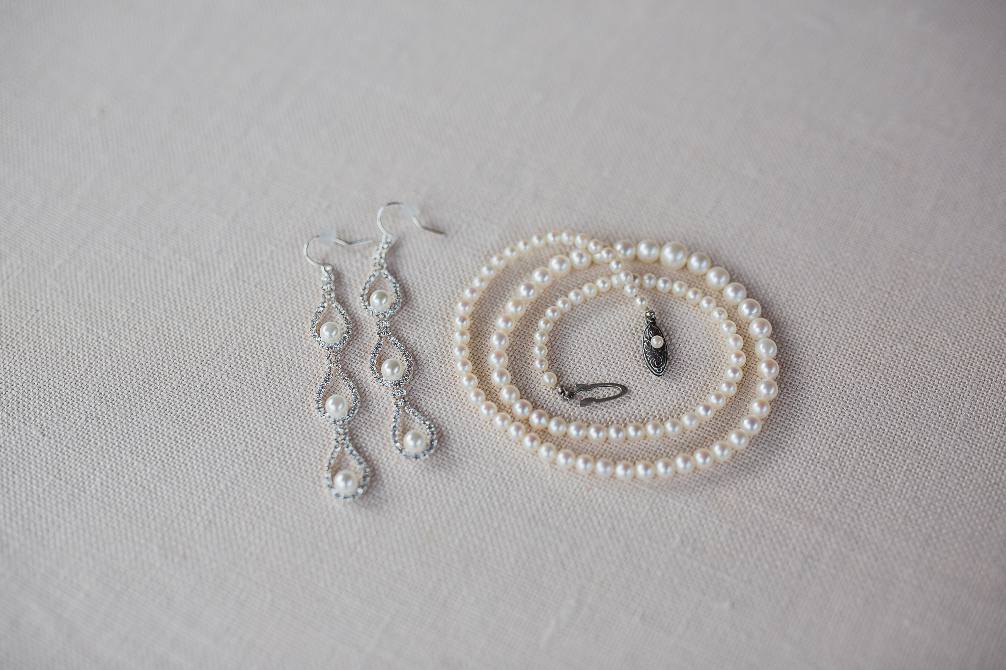 detail shot of brides jewelry on wedding day