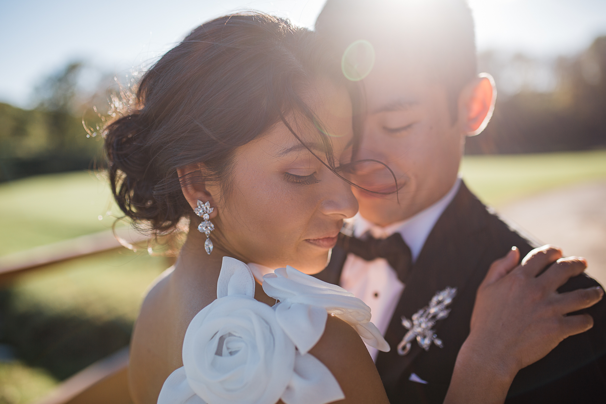 bride and groom intimate pose outdoors