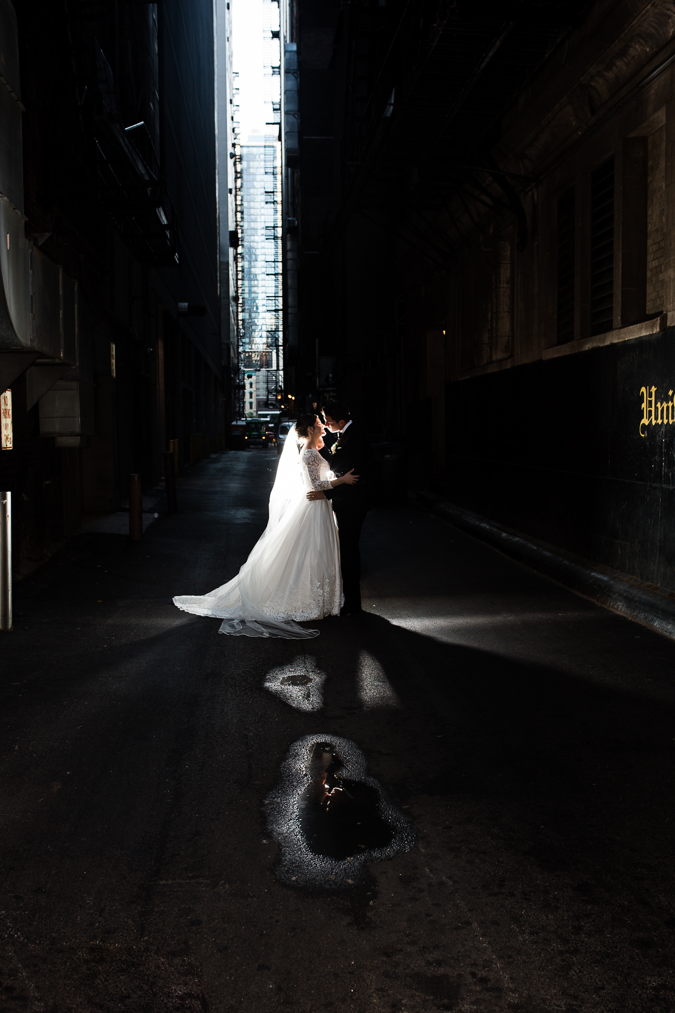 Bride and groom downtown