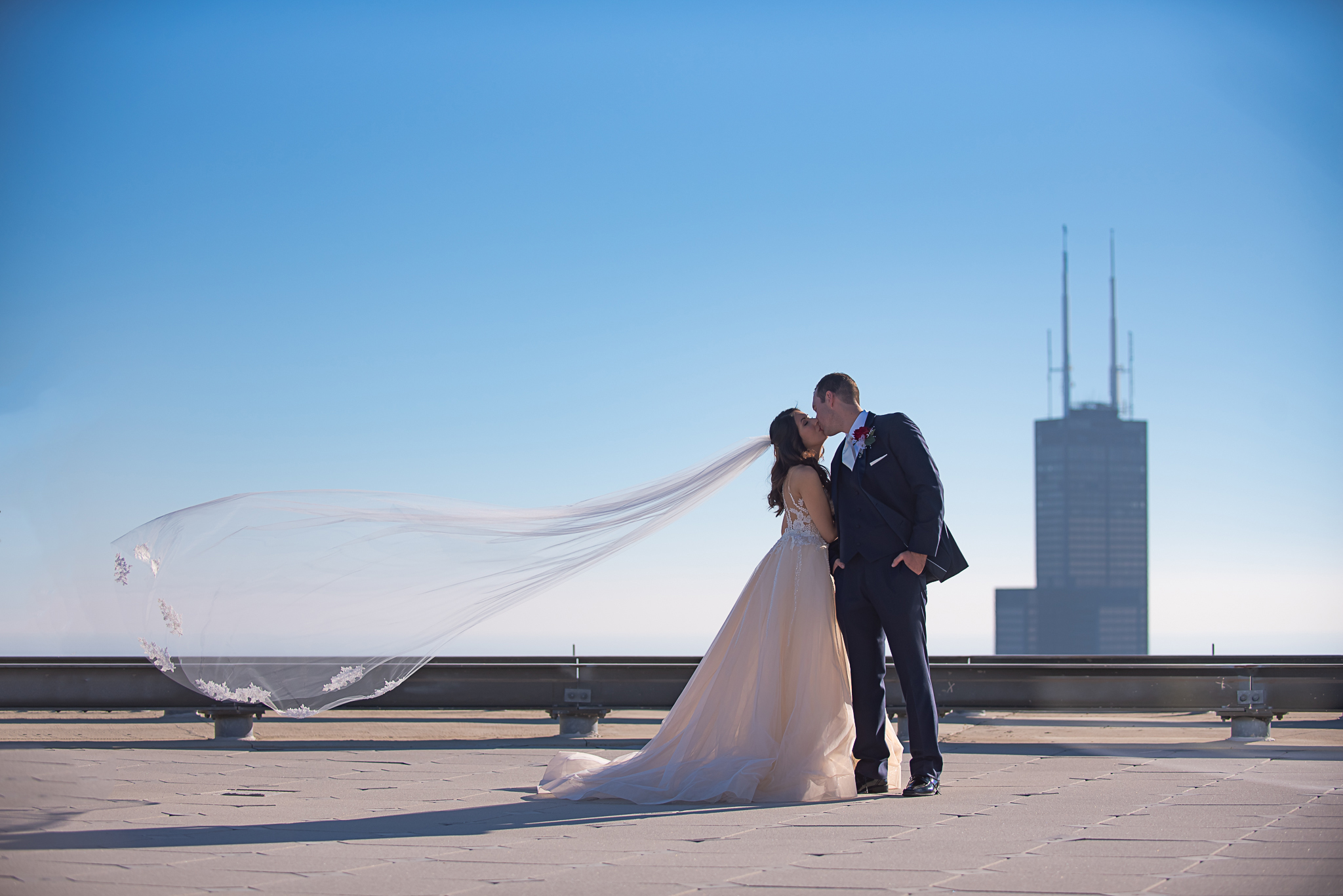 veil shot on top of rooftop with bride and groom