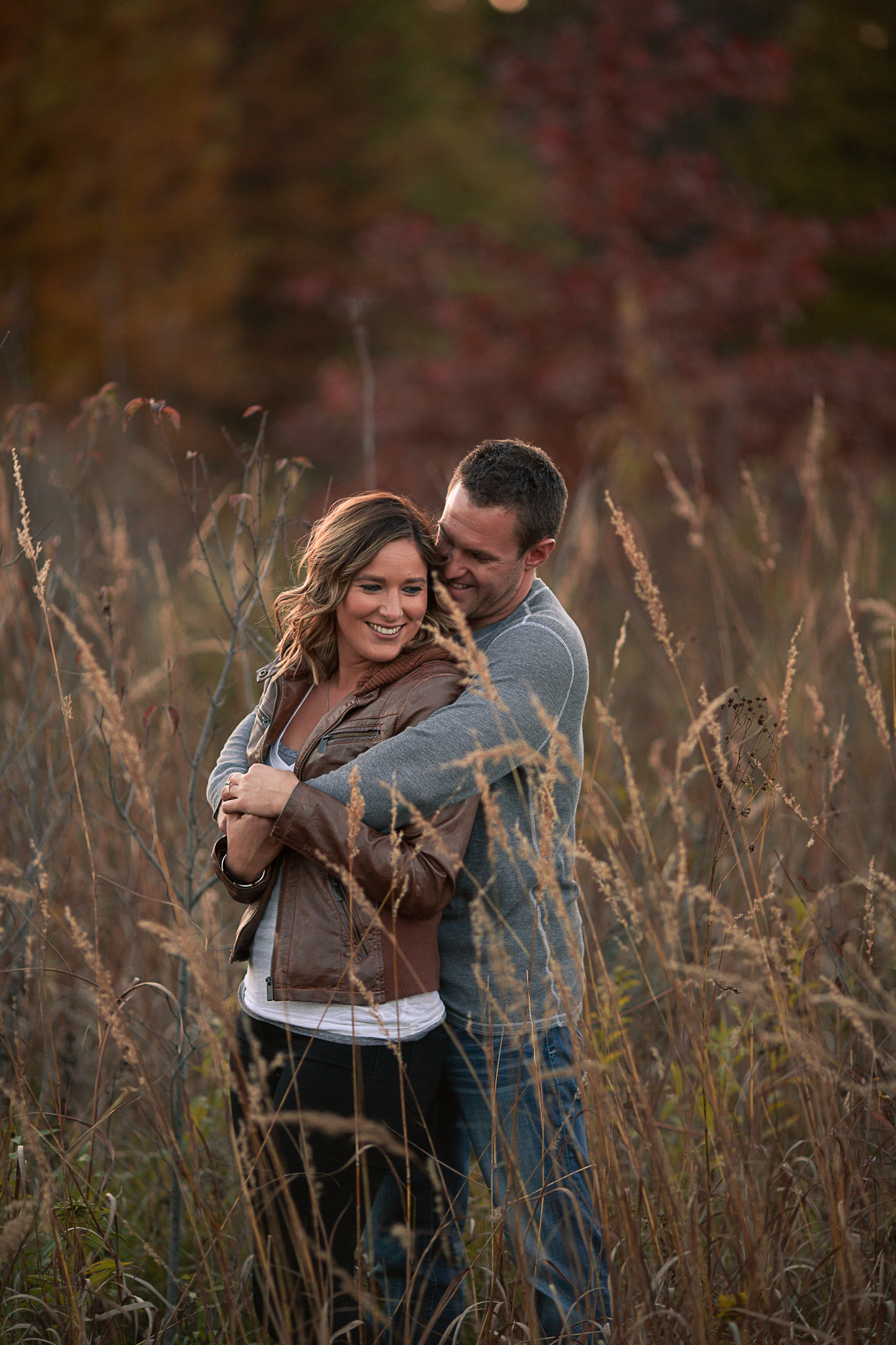 engagement session outdoors hugging each other