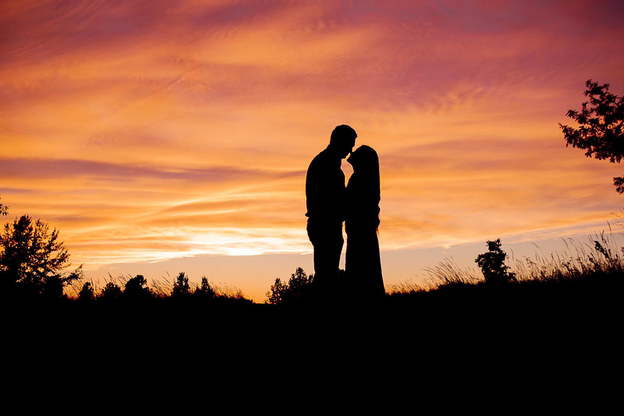 silhouette photo of couple at sunset
