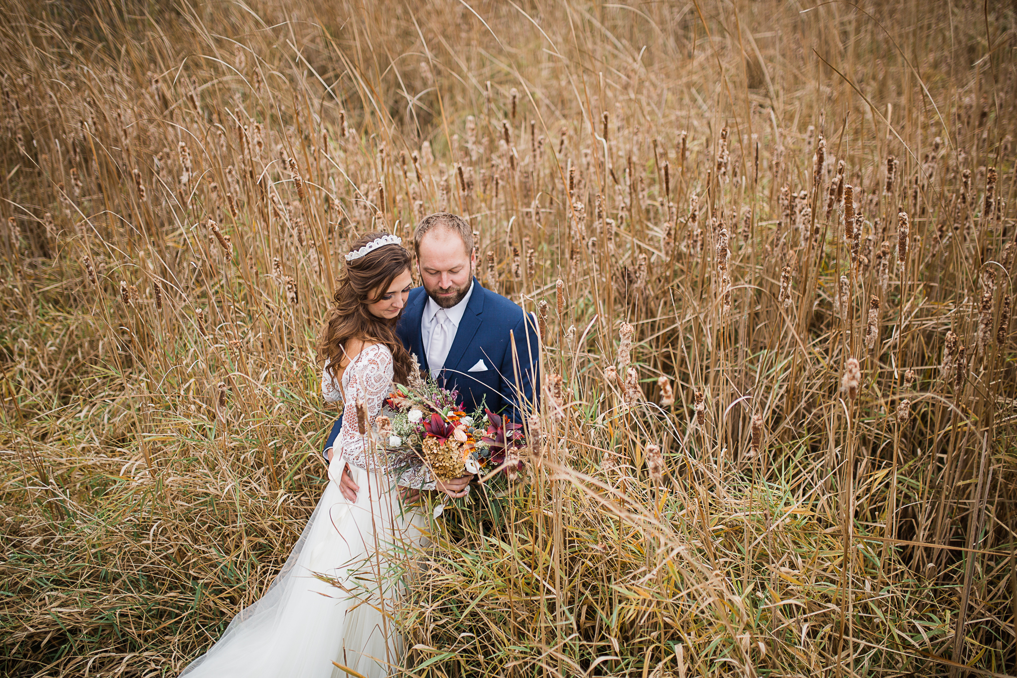bride and groom posing outdoor in the field