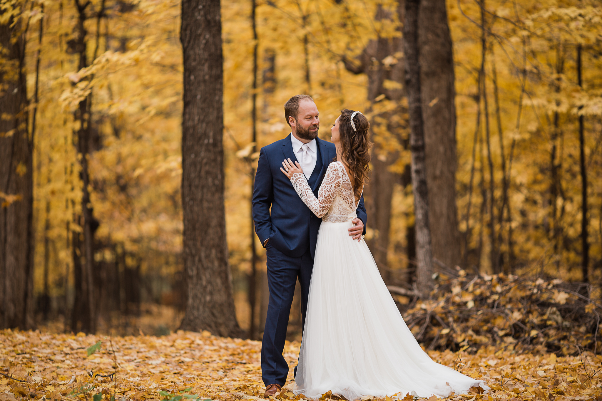 bride and groom posing outdoors in fall