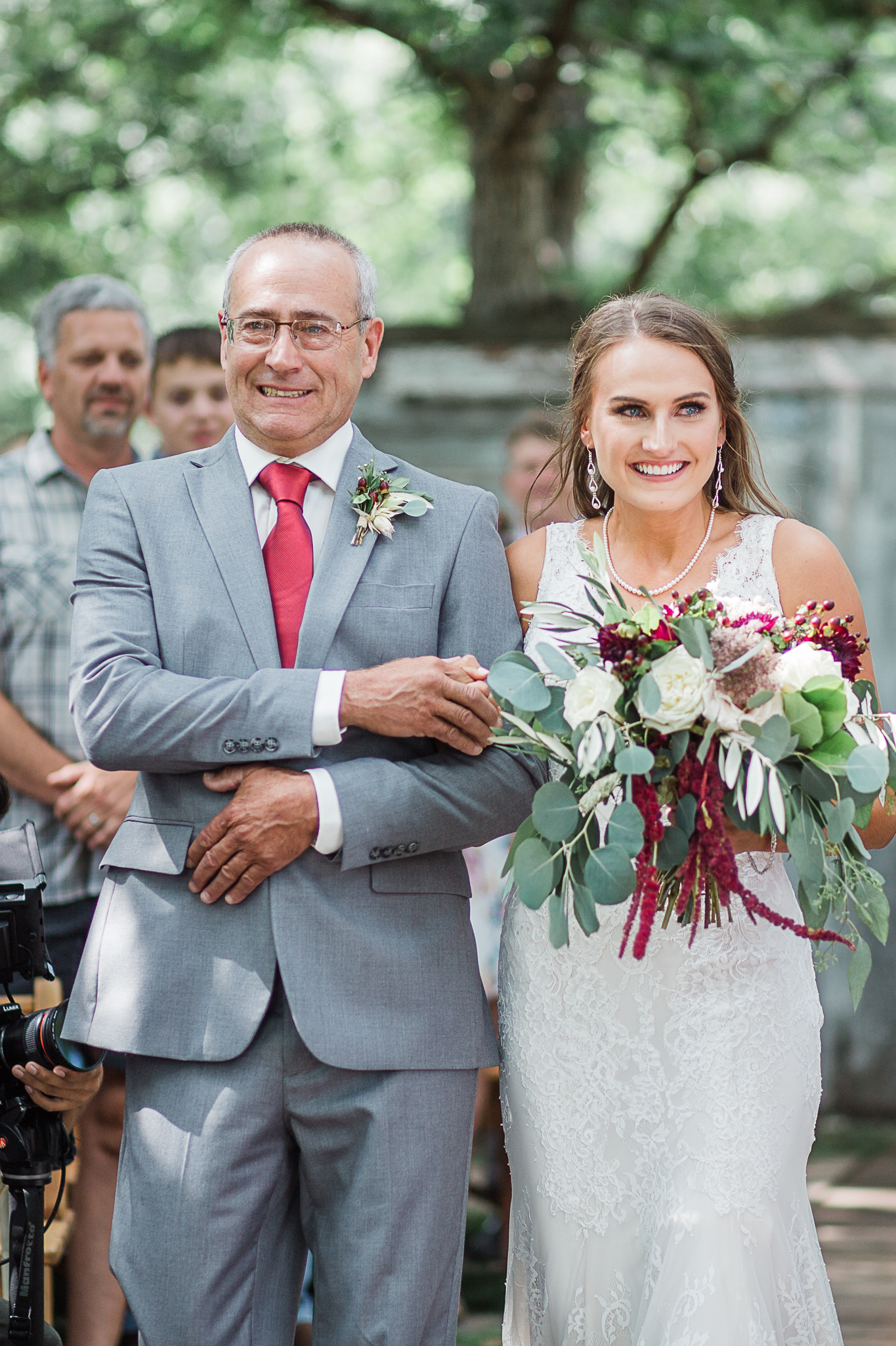 bride and father walking down the isle