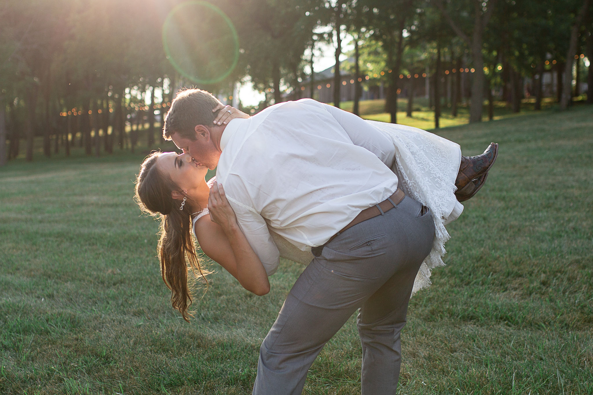 groom dipping bride for a kiss