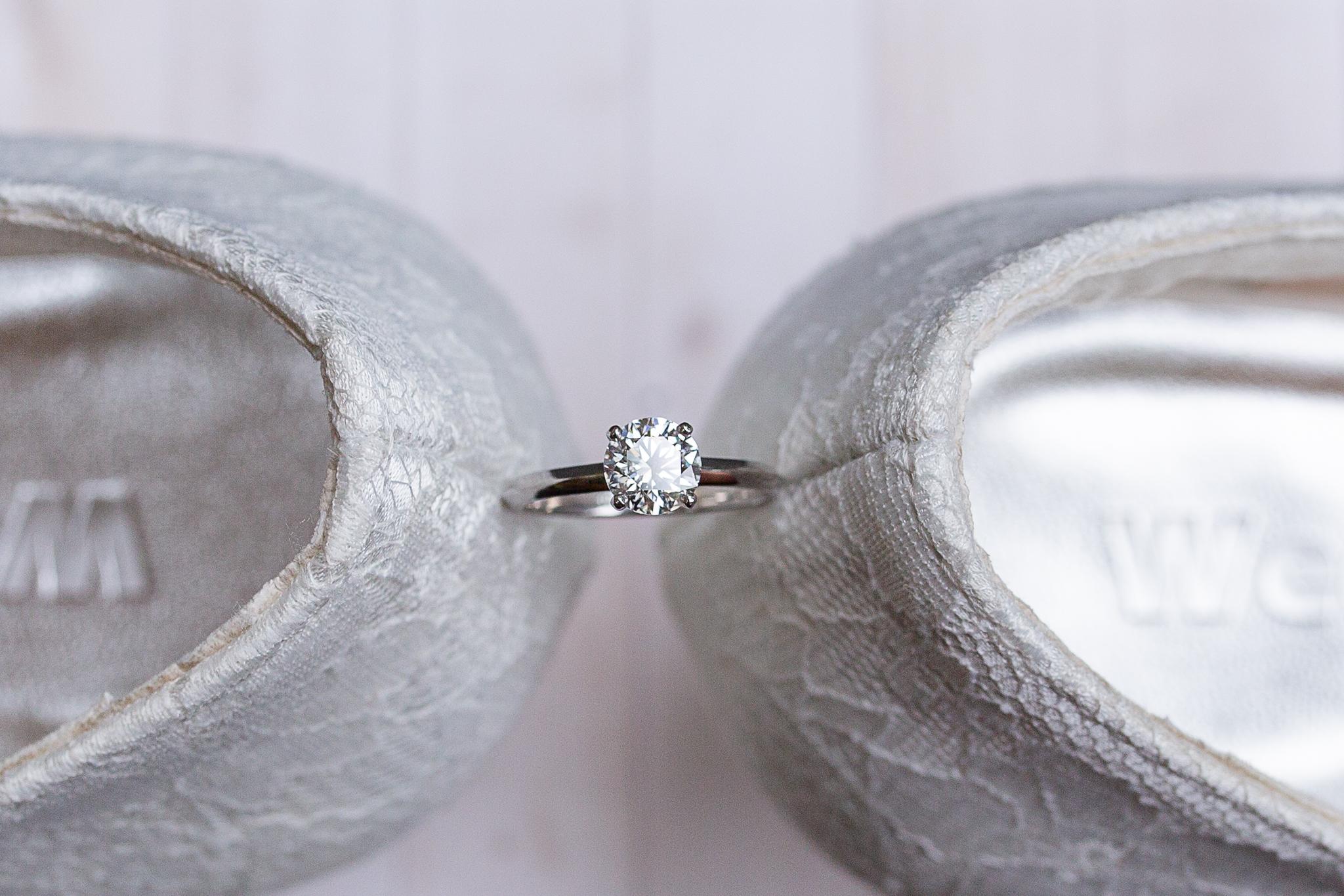 detail shot of wedding ring and brides heels