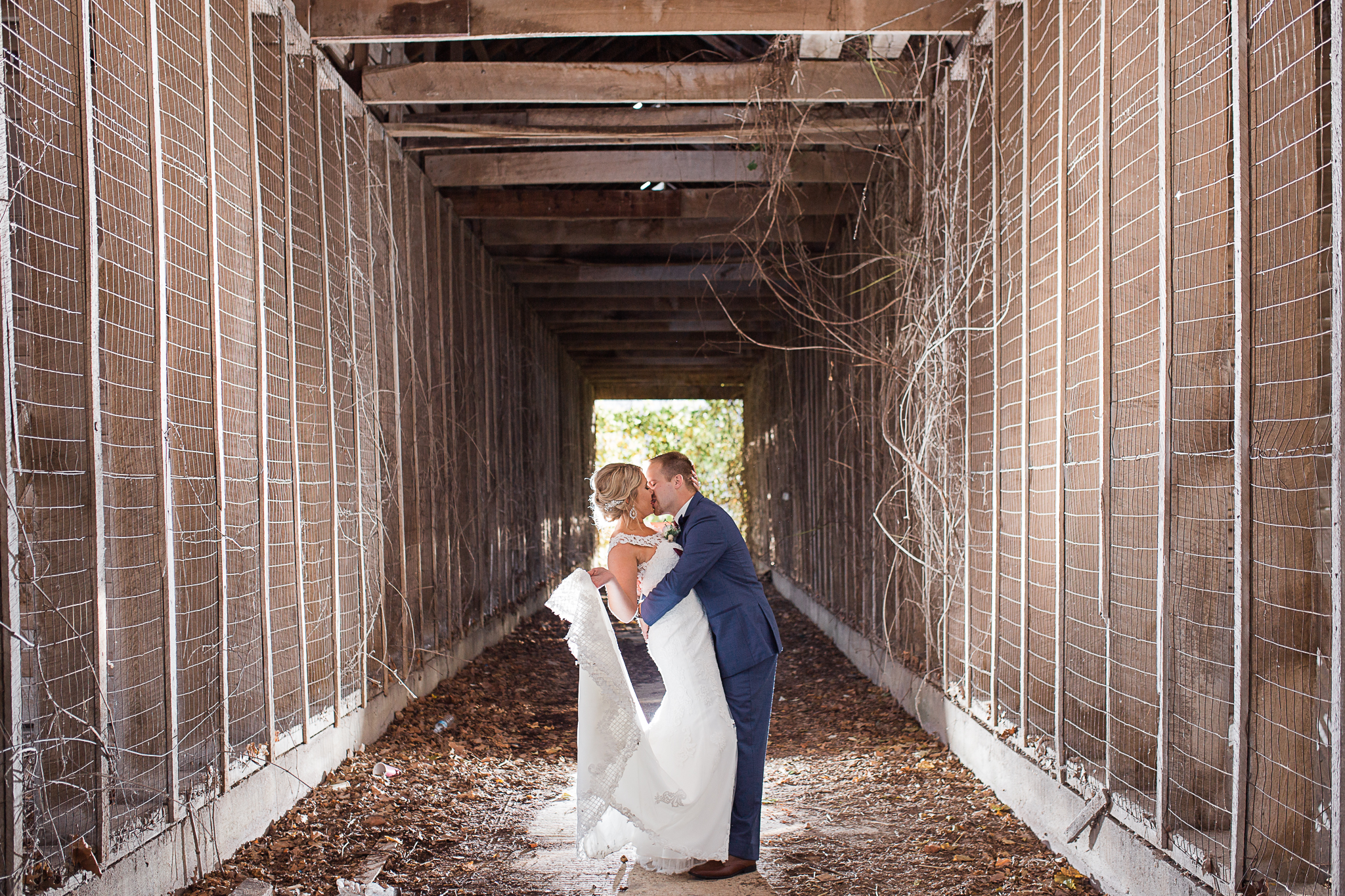 dramatic shot of bride and groom in barn