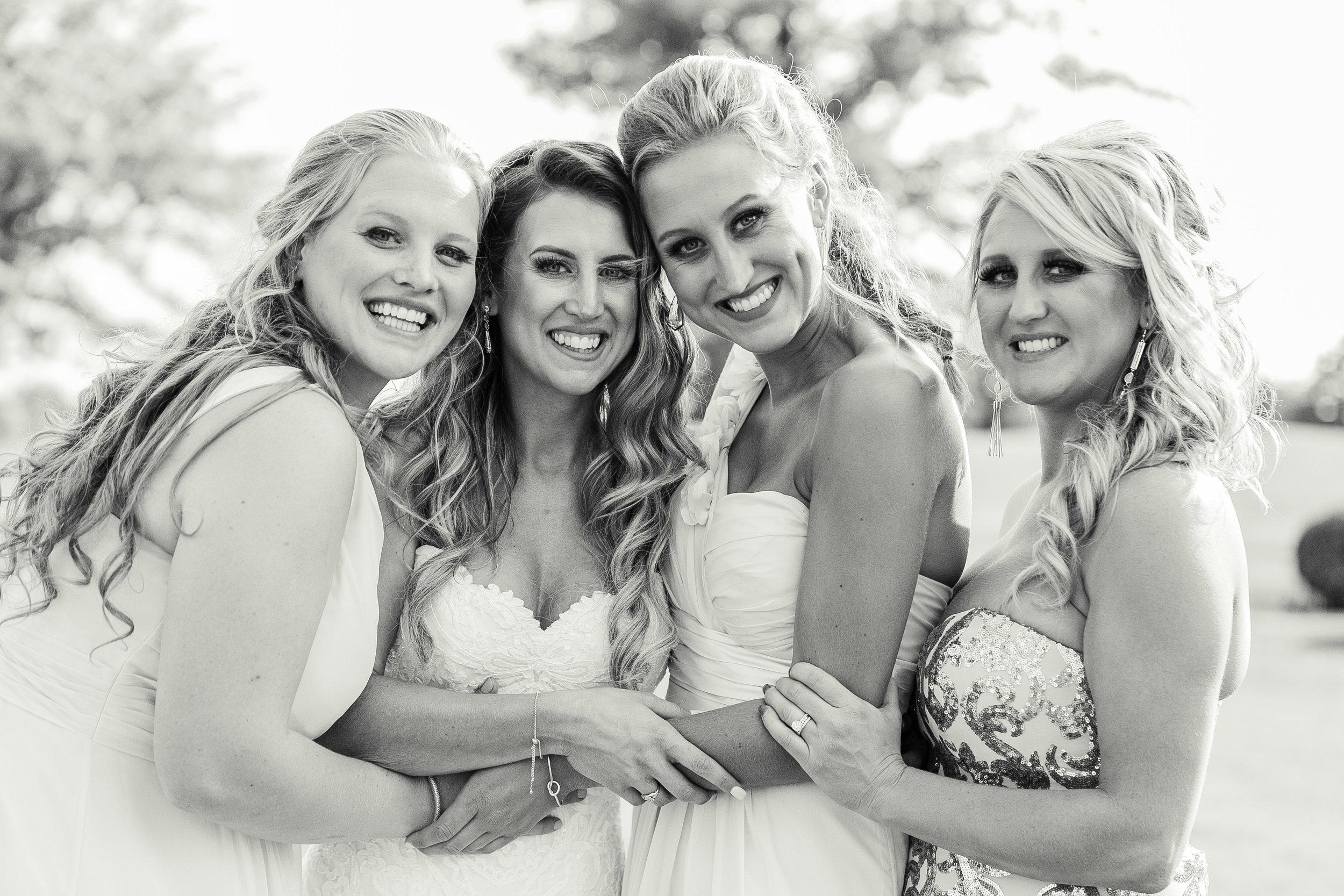 bridesmaids hugging bride