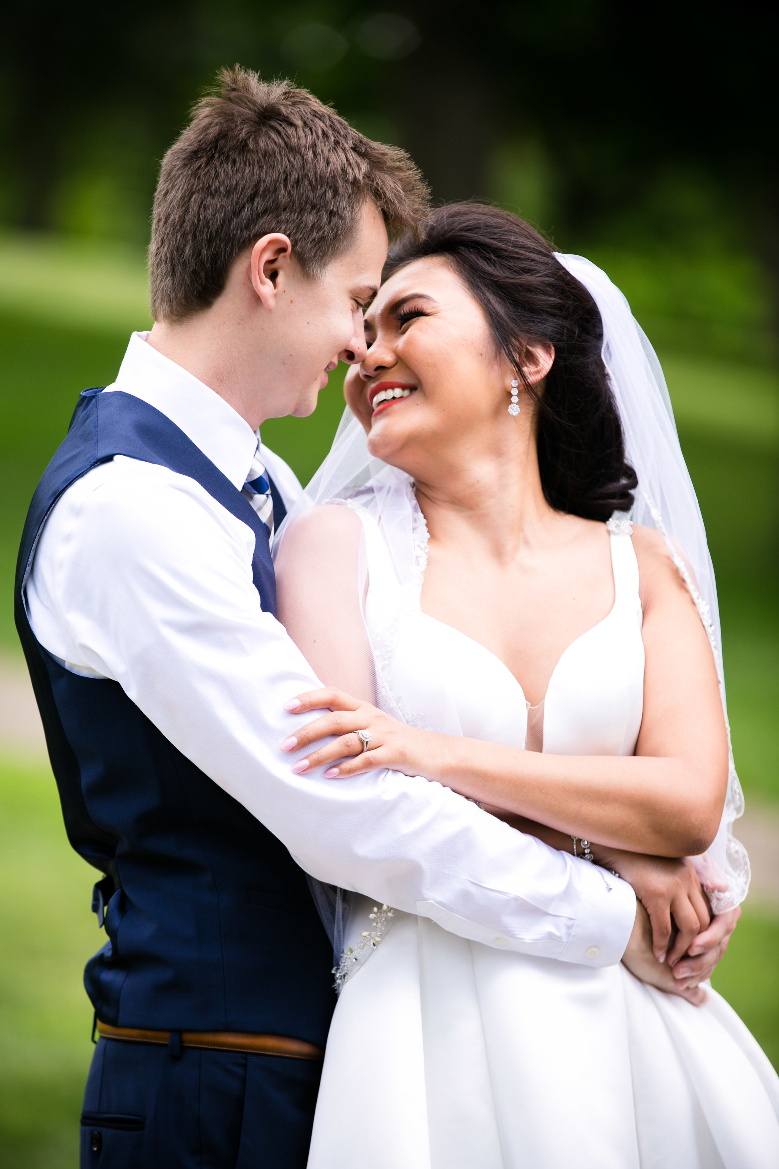 grooms arms wrapped around bride