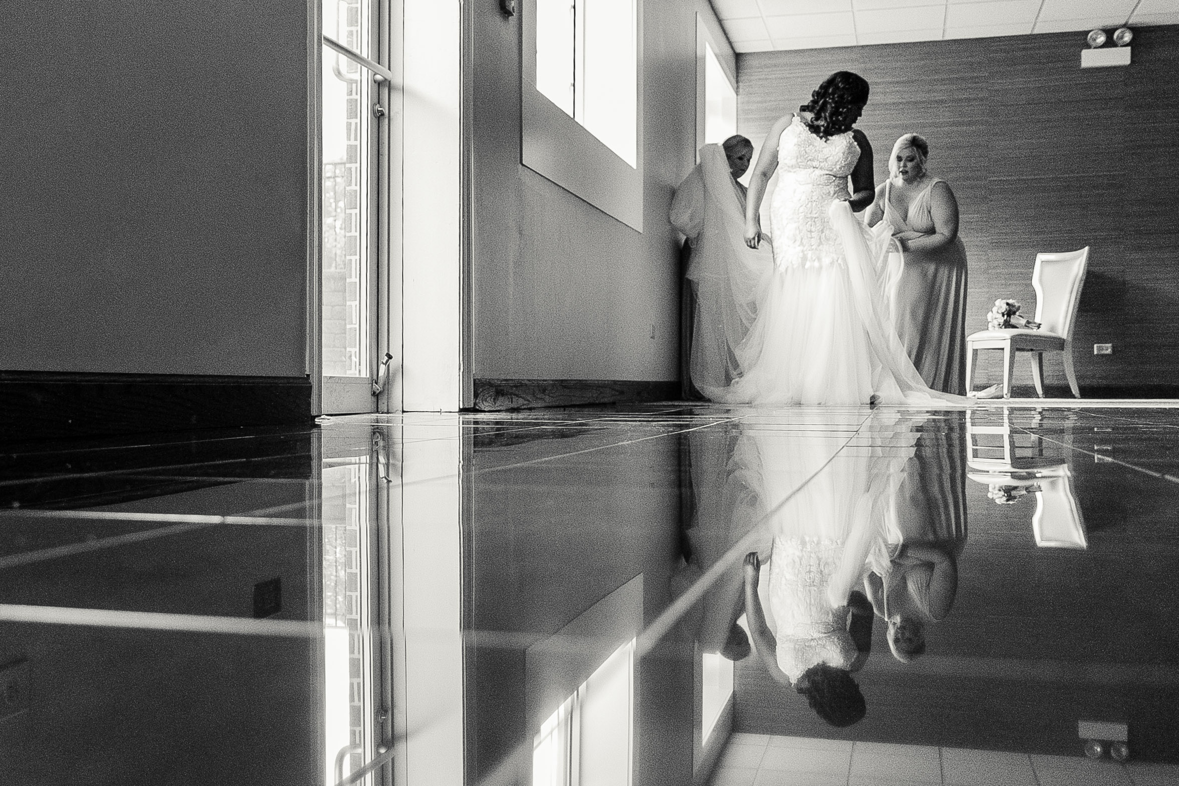 reflection shot of bride getting ready