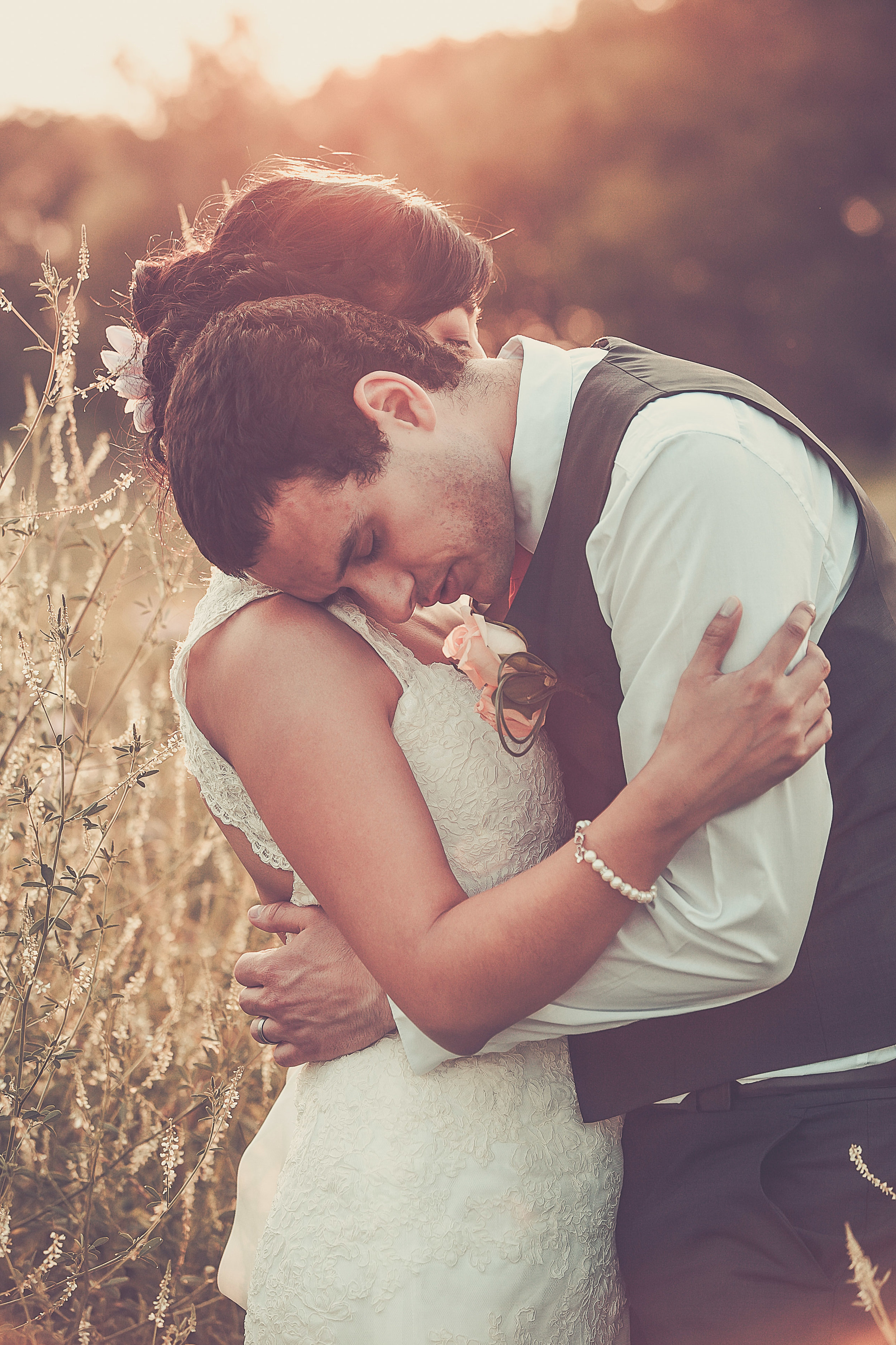 groom resting on brides shoulder