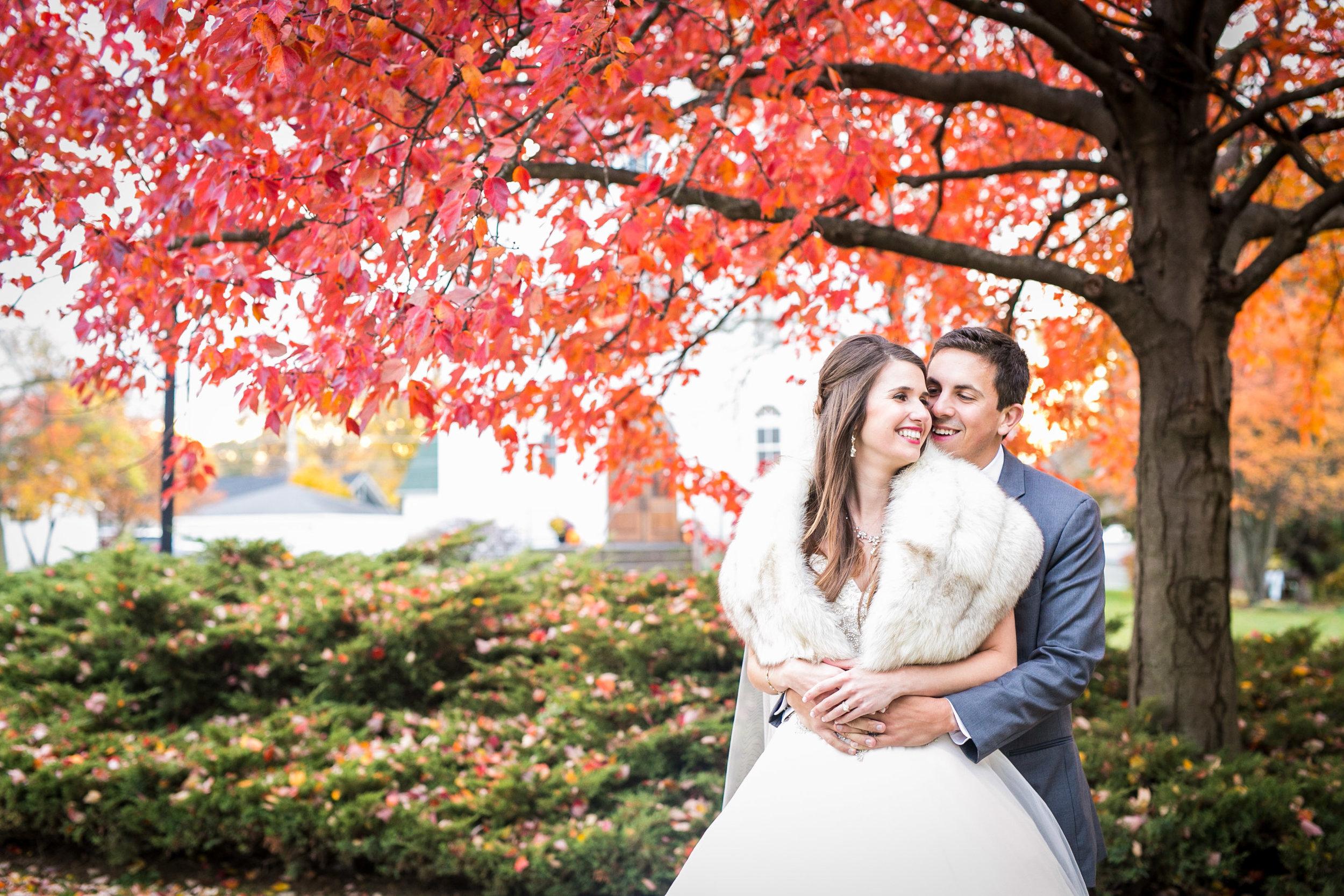 bride and groom hugging outdoors