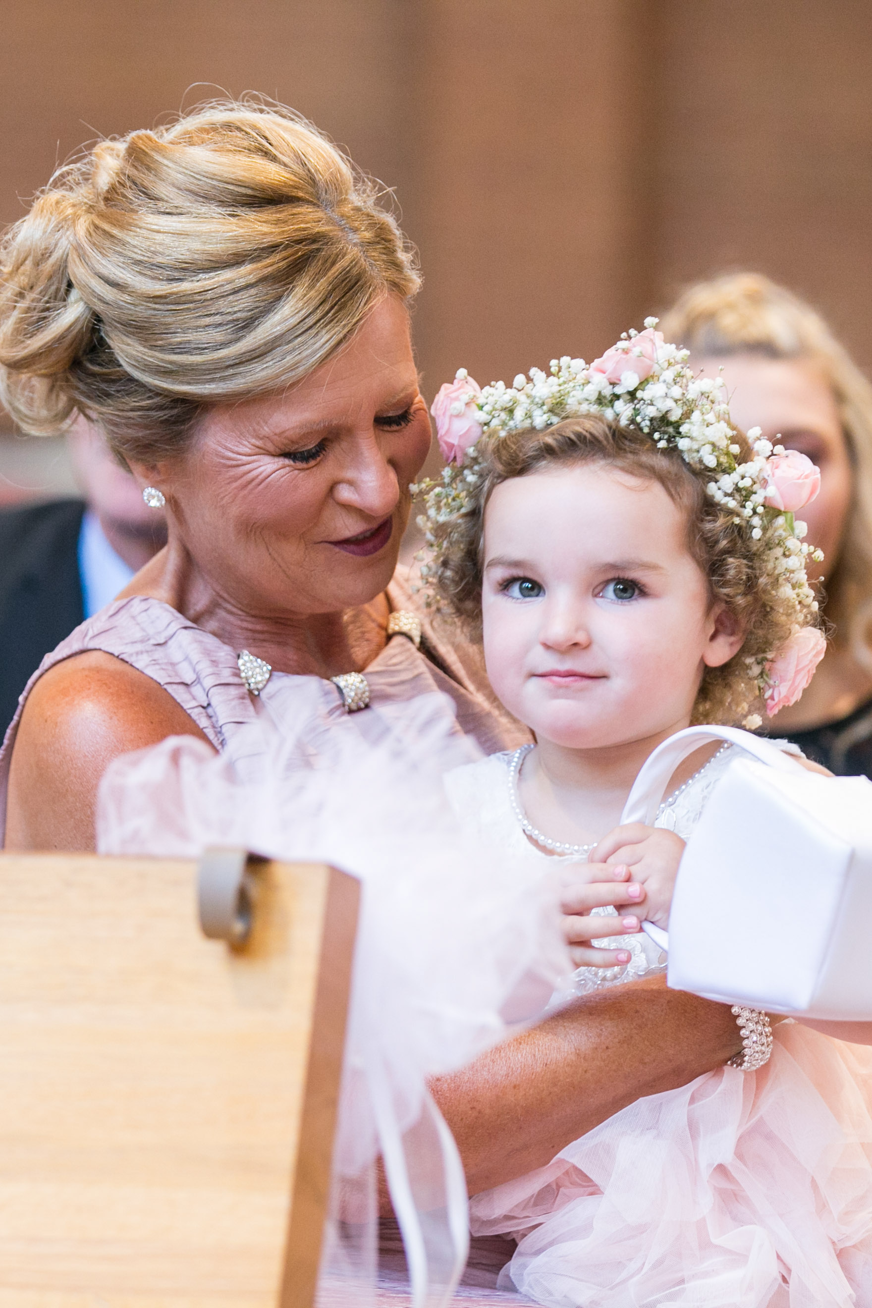 flower girl sitting with mother of the bride